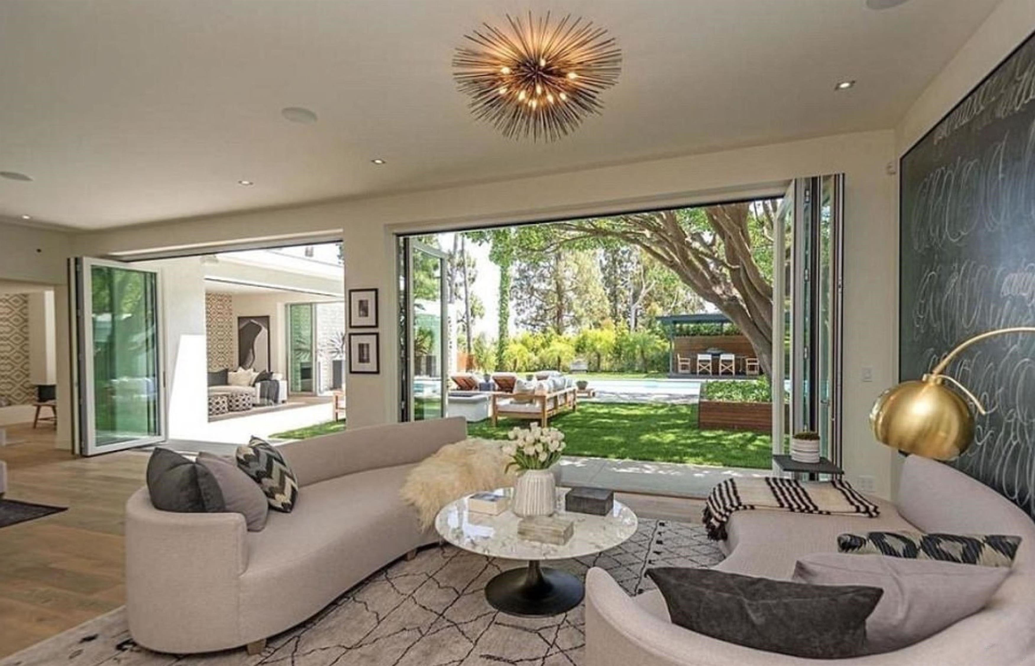** RIGHTS: WORLDWIDE EXCEPT IN UNITED STATES ** Los Angeles, CA  - Cindy Crawford and Randy Gerber splash out  million on new Beverly Hills home. The Hollywood couple put their luxury Malibu abode on the market in November 2016 for a cool million - and now they have swapped their seaside home for a jaw-dropping pad in Beverly Hills. According to US reports, they purchased the one-storey contemporary home  in the idyllic 90210 zip code for million. The property is located in trhe neighbourhood of Trousdale Estates and was originally listed for an eye-water .75million. The deal reportedly closed earlier this week with the dynamic couple purchasing the home from OneRepublic singer Ryan Tedder - who has worked with U2, Beyonce, Adele and Ed Sheeran. Cindy and Rande's four bedroom property is equipped with an impressive outdoor area and pool and a fire pit. The modern home boasts an open plan living area and kitchen which flows perfectly into their manicured lawns and incredible view over the city with the help of folding glass doors. Flooding  Pictured: Cindy Crawford, Randy Gerber  BACKGRID UK 14 SEPTEMBER 2017, Image: 349341315, License: Rights-managed, Restrictions: , Model Release: no, Credit line: Profimedia, Xposurephotos