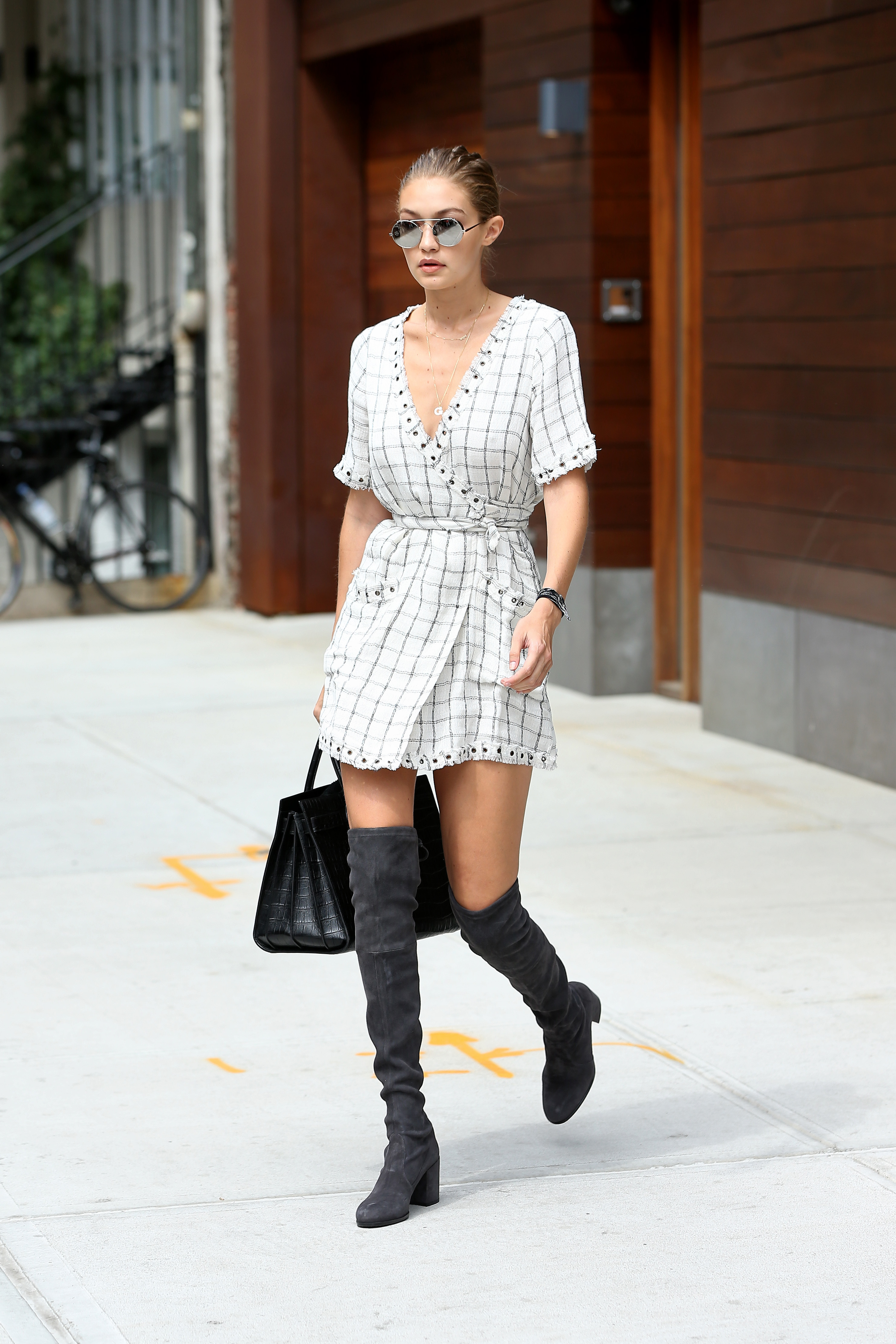 Model Gigi Hadid leaves her apartment in New York City, New York wearing a pinstriped shirt dress and knee high boots on September 5, 2016. <P> Pictured: Gigi Hadid <B>Ref: SPL1345859  050916  </B><BR/> Picture by: Christopher Peterson/Splash News<BR/> </P><P> <B>Splash News and Pictures</B><BR/> Los Angeles:310-821-2666<BR/> New York:212-619-2666<BR/> London:870-934-2666<BR/> <span id=