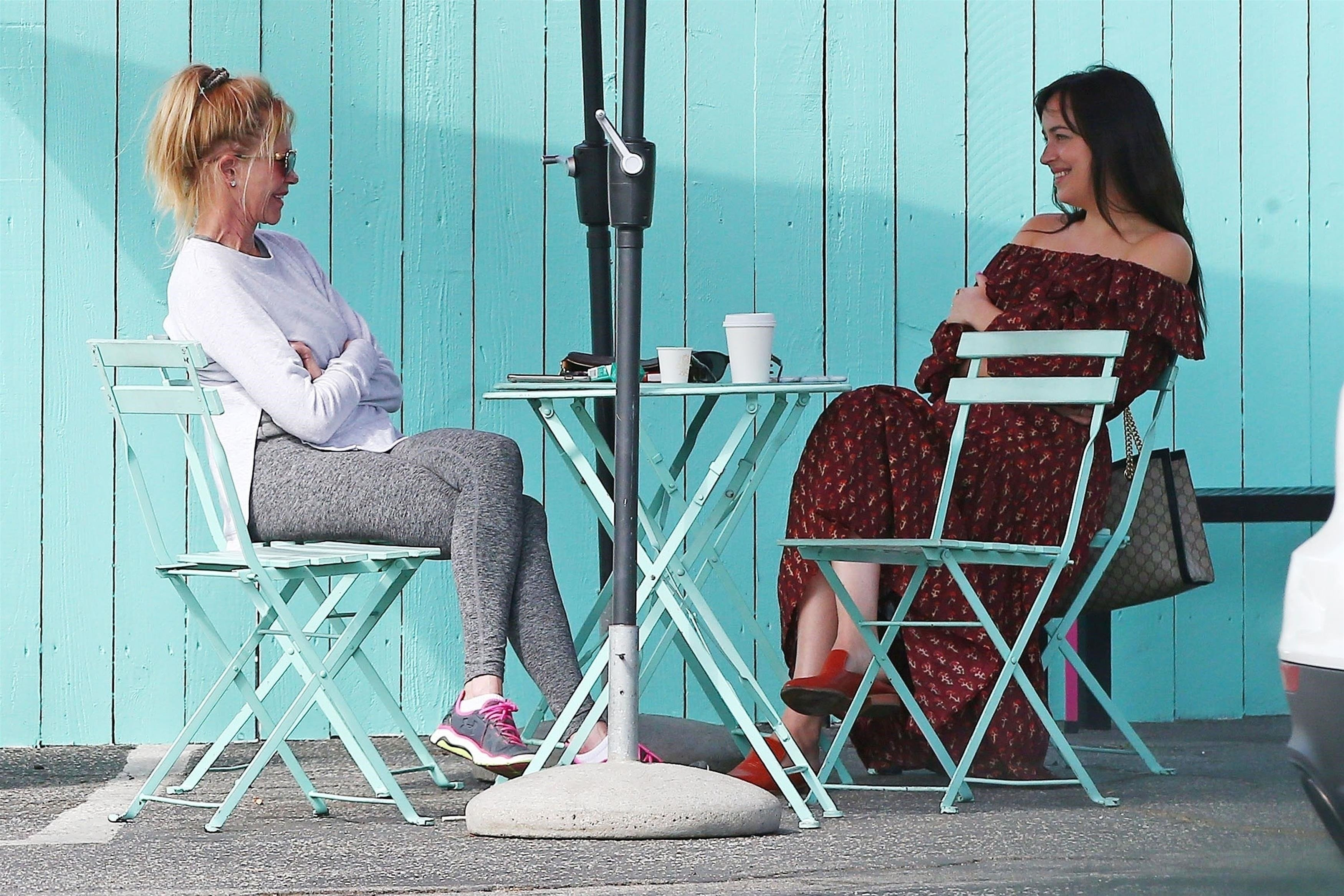 West Hollywood, CA  - *EXCLUSIVE*  - Actress Melanie Griffith and her daughter Dakota Johnson are spotted catching up over coffee in West Hollywood. The pair laughed and chatted before getting up giving each other a hug and kiss and heading on their way.  Pictured: Melanie Griffith, Dakota Johnson  BACKGRID USA 14 SEPTEMBER 2017, Image: 349403151, License: Rights-managed, Restrictions: , Model Release: no, Credit line: Profimedia, AKM-GSI