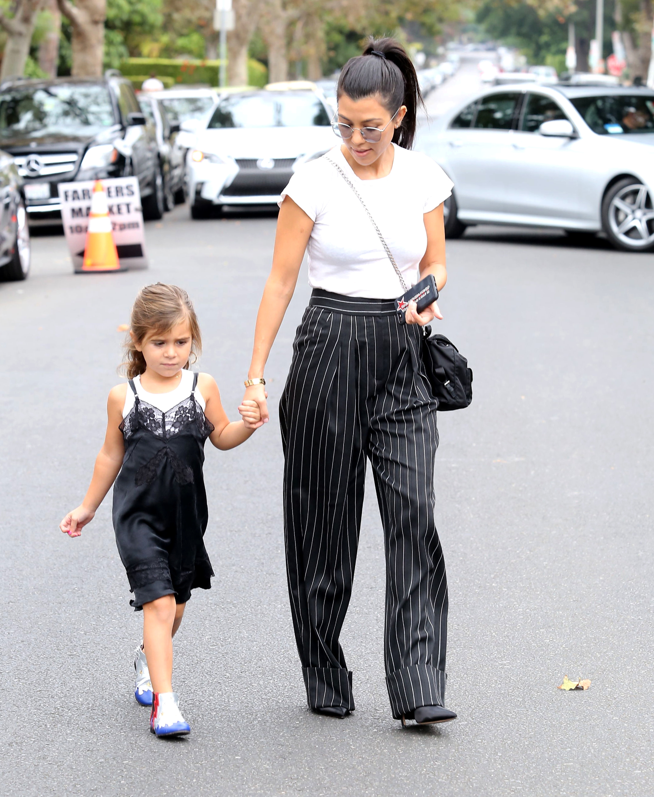 Kourtney Kardashian and her beautiful daughter Penelope got out for some Sunday afternoon socializing in Calabasas. September 17, 2017 X17online.com