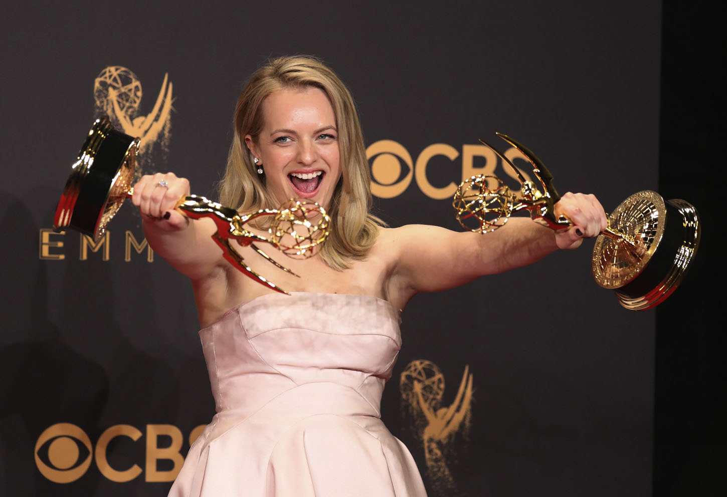 69th Primetime Emmy Awards Äì Photo Room Äì Los Angeles, California, U.S., 17/09/2017 - Elizabeth Moss poses backstage with her awards for Outstanding Lead Actress in a Drama Series and  Outstanding Drama Series for
