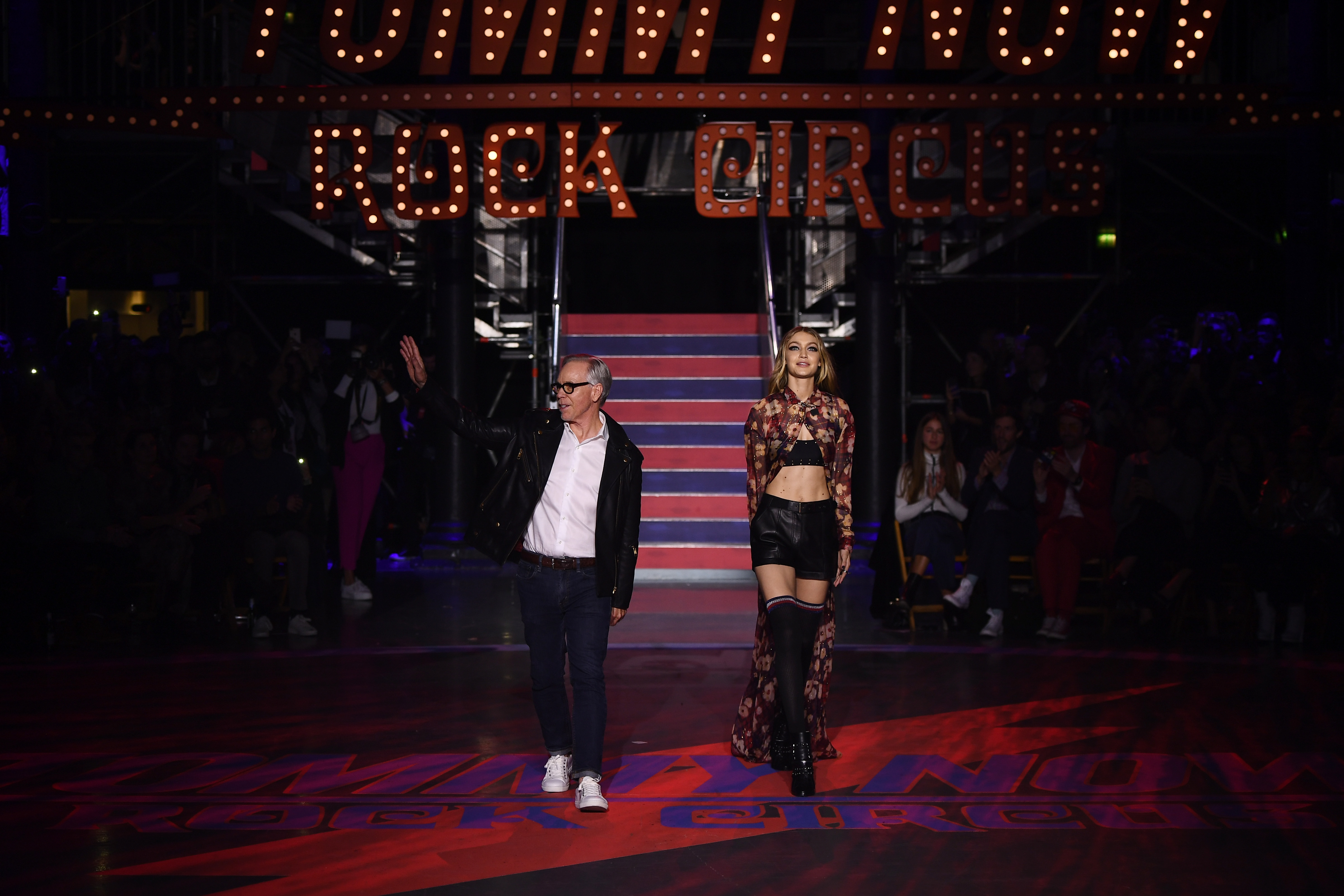 LONDON, ENGLAND - SEPTEMBER 19:  Fashion designer Tommy Hilfiger and model Gigi Hadid are seen on the runway at the Tommy Hilfiger TOMMYNOW Fall 2017 Show during London Fashion Week September 2017 at the Roundhouse on September 19, 2017 in London, England.  (Photo by Ian Gavan/Getty Images for Tommy Hilfiger)