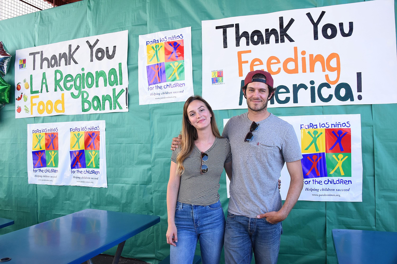 LOS ANGELES, CA - JUNE 27:  Leighton Meester and Adam Brody volunteer at Feeding America's Summer Hunger Awareness event At Para Los Ninos in Los Angeles on June 27, 2017 in Los Angeles, California.  (Photo by Araya Diaz/Getty Images)