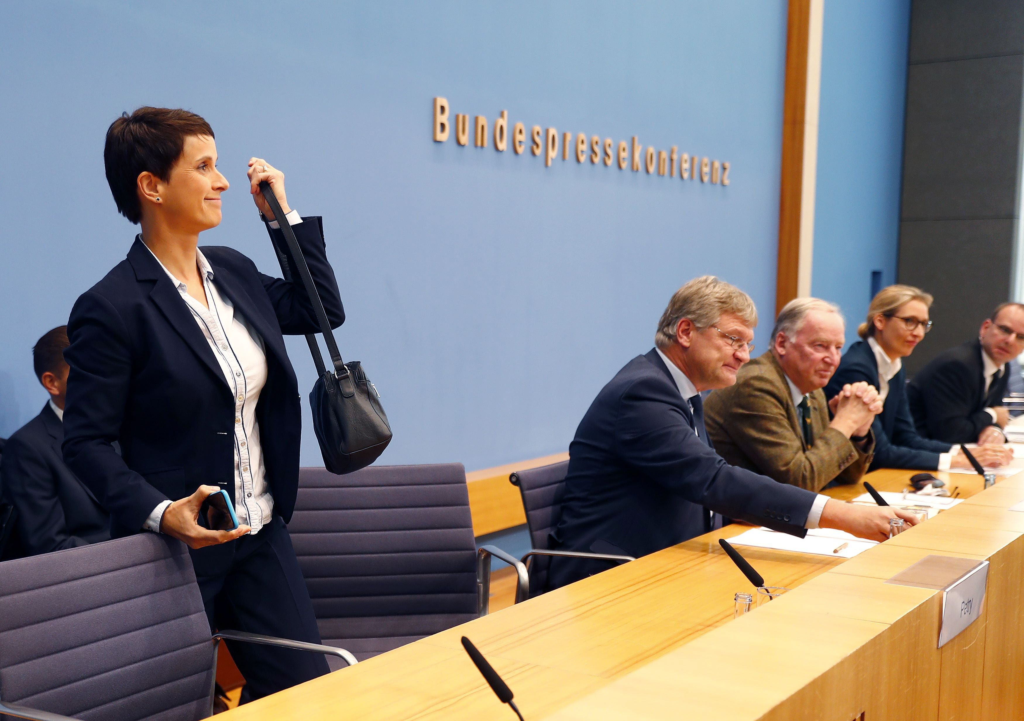 Frauke Petry, chairwoman of the anti-immigration party Alternative fuer Deutschland (AfD) leaves a news conference next to Joerg Meuthen (2nd L), leader of the party and top candidates Alice Weidel (2nd R) and Alexander Gauland in Berlin, Germany, September 25, 2017. REUTERS/Fabrizio Bensch