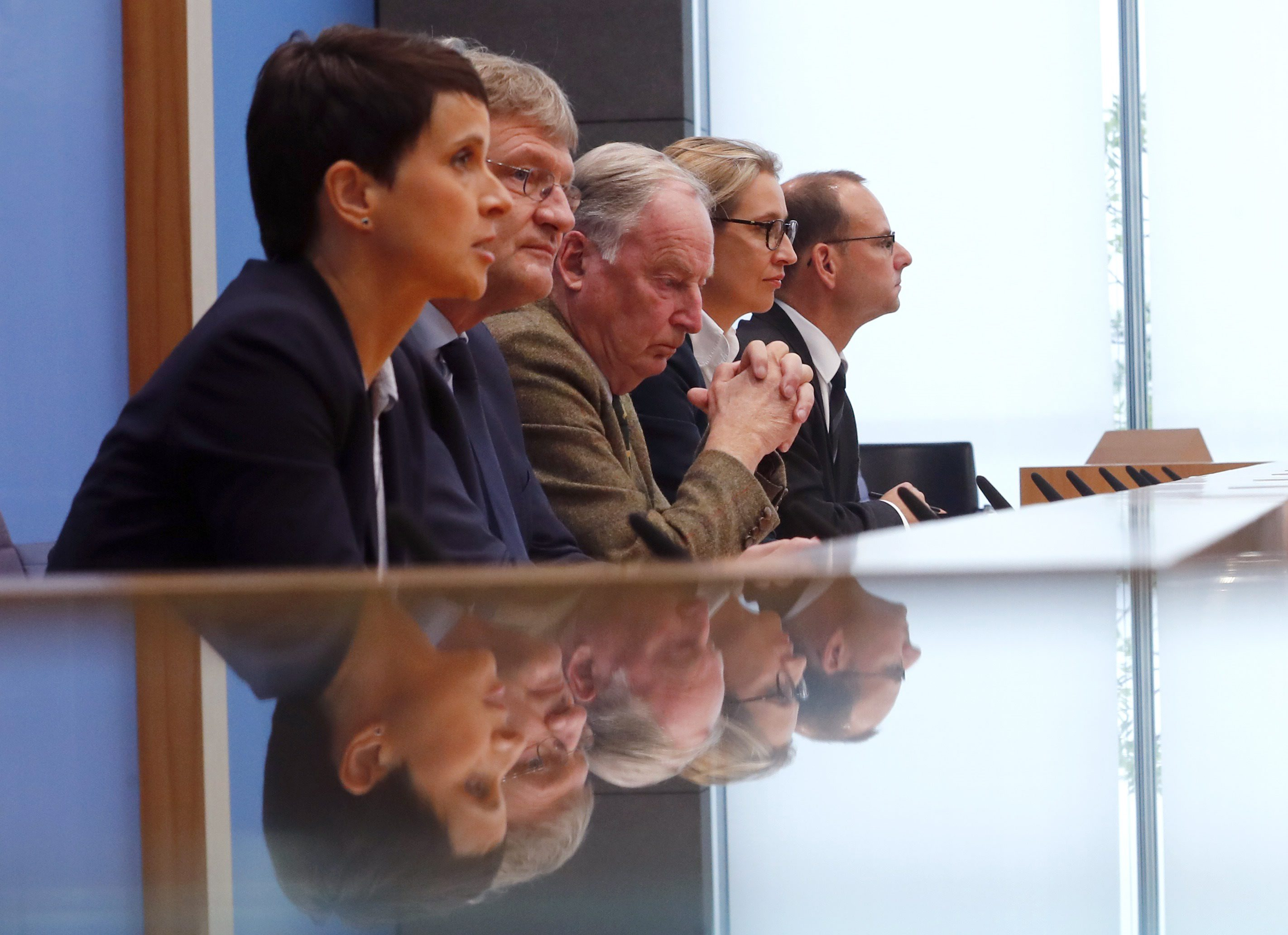 Frauke Petry (L), chairwoman of the anti-immigration party Alternative fuer Deutschland (AfD) speaks next to Joerg Meuthen (2nd L), leader of the party and top candidates Alice Weidel (2nd R) and Alexander Gauland before a news conference in Berlin, Germany, September 25, 2017. REUTERS/Fabrizio Bensch