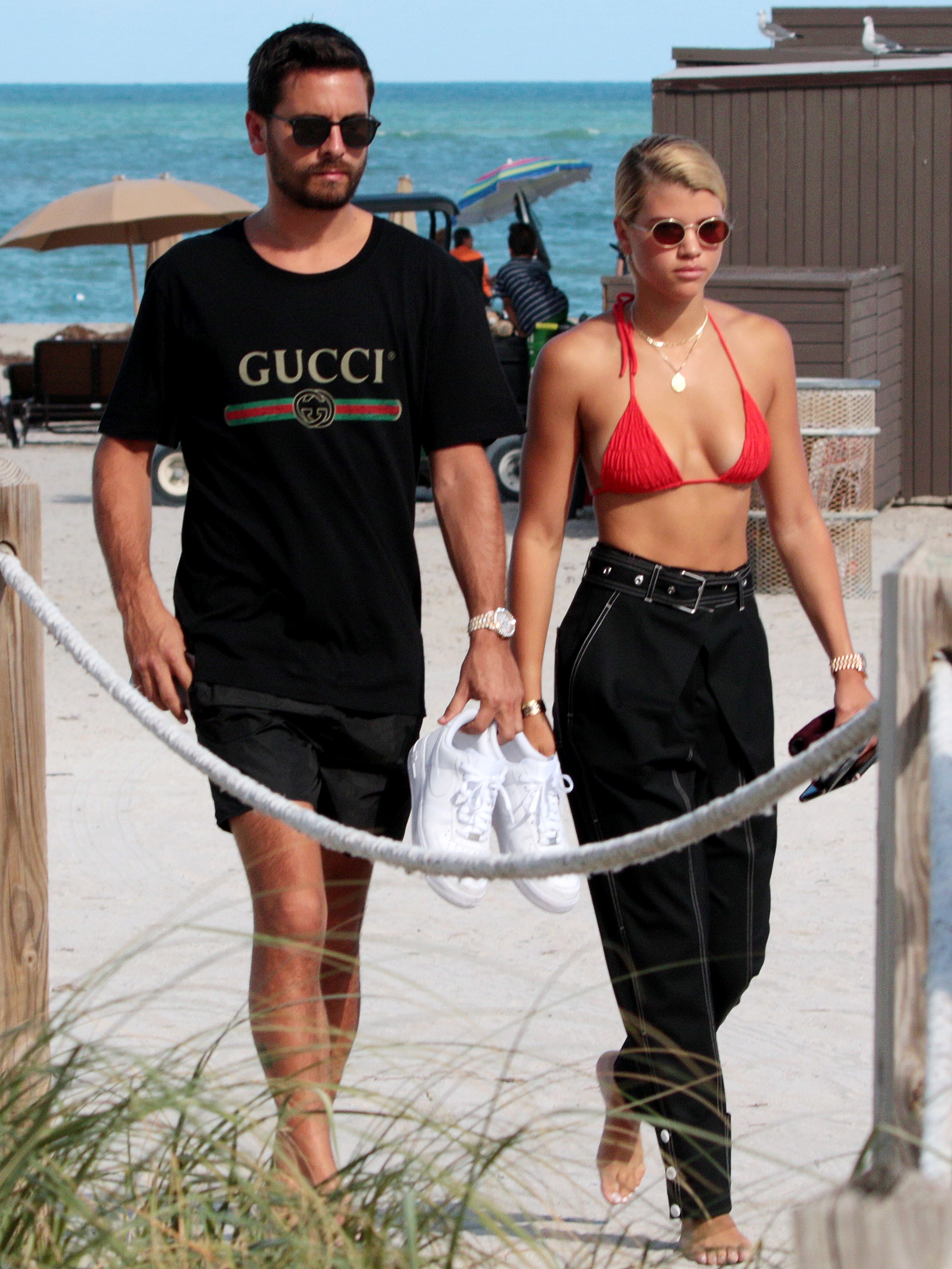 NO JUST JARED USAGE<BR/> Scott Disick new girlfriend Sofia Richie in a skimpy red bikini top taking a walk by the beach in Miami, Florida.  <P> Pictured: Scott Disick, Sofia Richie <B>Ref: SPL1586963  230917  </B><BR/> Picture by: Splash News<BR/> </P><P> <B>Splash News and Pictures</B><BR/> Los Angeles:310-821-2666<BR/> New York:212-619-2666<BR/> London:870-934-2666<BR/> <span id=