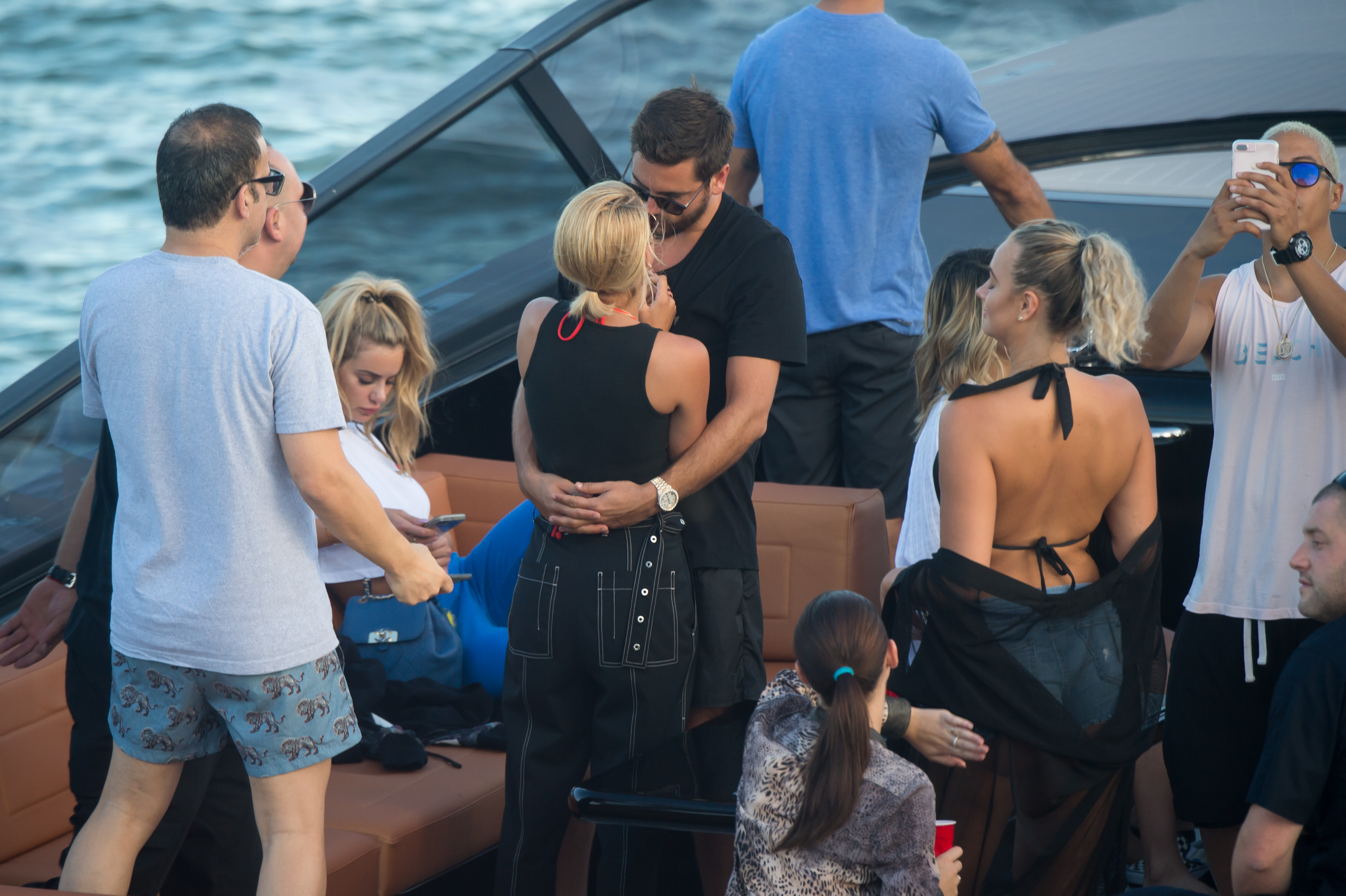 Sofia Richie and Scott Disick get up close during sunset boat tour through Miami. The newly couple were out on David Grutmans boat who owns the famous LIV club in Miami Beach  <P> Pictured: scott disick, sofia richie <B>Ref: SPL1586675  230917  </B><BR/> Picture by: AM/Splashnews<BR/> </P><P> <B>Splash News and Pictures</B><BR/> Los Angeles:310-821-2666<BR/> New York:212-619-2666<BR/> London:870-934-2666<BR/> <span id=