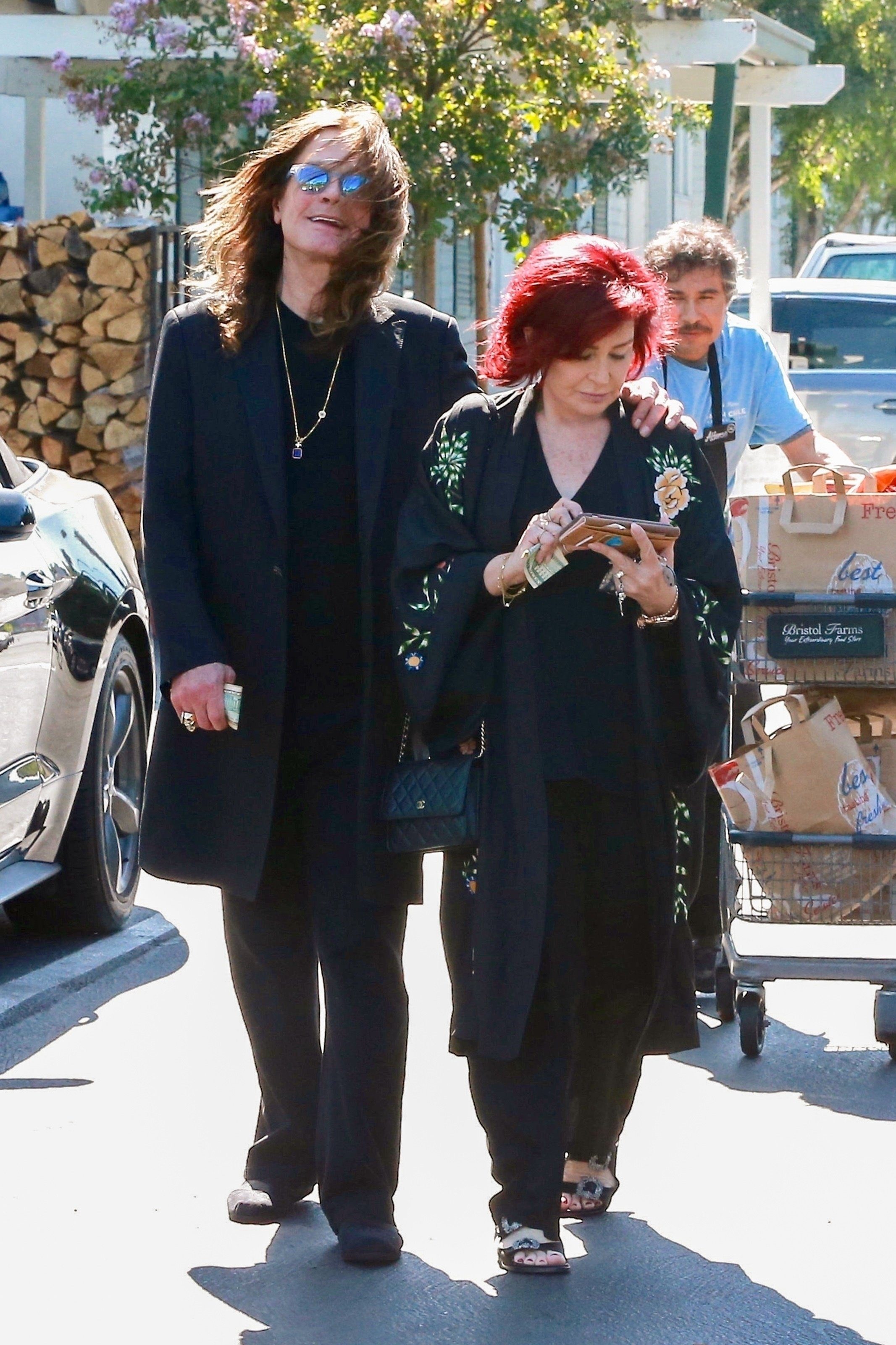 West Hollywood, CA  - *EXCLUSIVE* Sharon and Ozzy Osbourne do some grocery shopping at Bristol Farms in West Hollywood. Sharon and Ozzy return to their car with a full shopping cart and some help from a store employee, Ozzy smiles for the cameras as Sharon can't be bothered while checking her phone and wallet along the way.  Pictured: Sharon Osbourne, Ozzy Osbourne  BACKGRID USA 19 AUGUST 2017   USA: +1 310 798 9111 / usasales@backgrid.com  UK: +44 208 344 2007 / uksales@backgrid.com  *UK Clients - Pictures Containing Children Please Pixelate Face Prior To Publication*, Image: 345910736, License: Rights-managed, Restrictions: , Model Release: no, Credit line: Profimedia, AKM-GSI