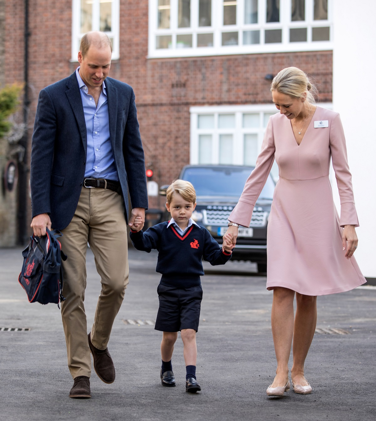Helen Haslem, head of the lower school and Britain's Prince William hold Prince George's hands as he arrives for his first day of school at Thomas's school in Battersea, London, September 7, 2017. REUTERS/Richard Pohle/Pool - RC1F7FFDD1F0