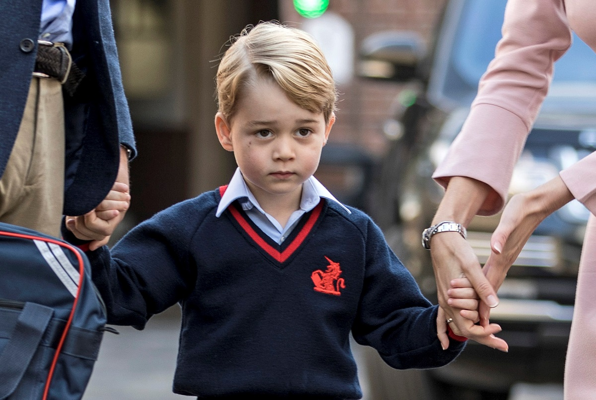 Helen Haslem, head of the lower school and Britain's Prince William hold Prince George's hands as he arrives for his first day of school at Thomas's school in Battersea, London, September 7, 2017. REUTERS/Richard Pohle/Pool - RC1CCA495CF0