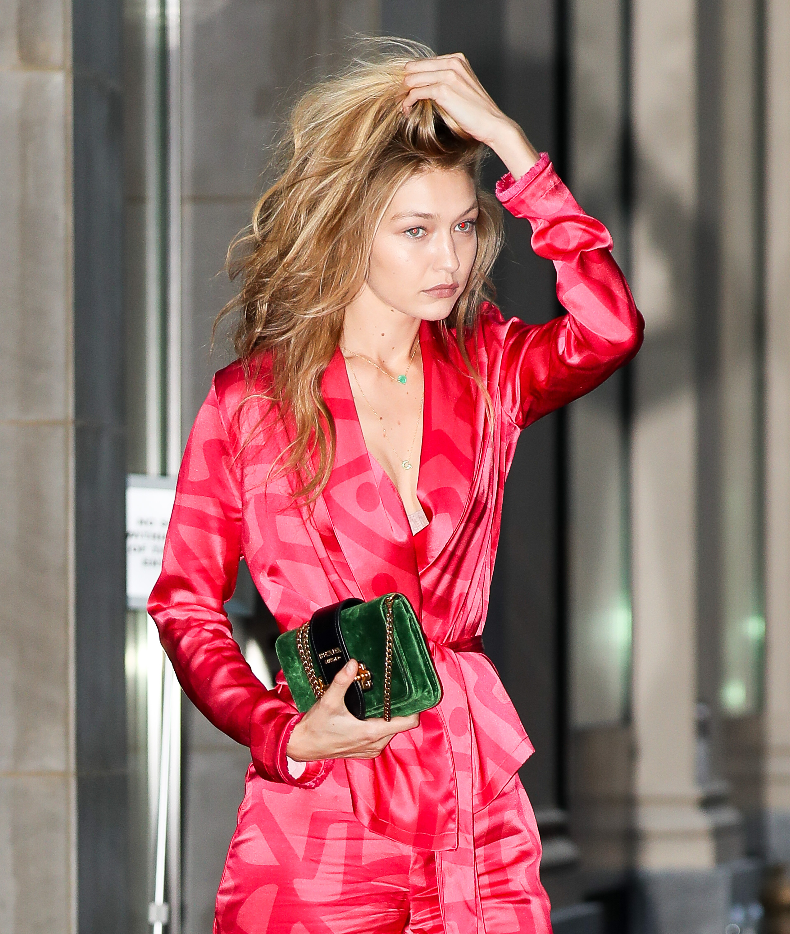 Gigi Hadid is all smiling while wearing a pink jumpsuit as leaving an office building in the Dimond district in Midtown, New York City. <P> Pictured: Gigi Hadid <B>Ref: SPL1571699  070917  </B><BR/> Picture by: Felipe Ramales / Splash News<BR/> </P><P> <B>Splash News and Pictures</B><BR/> Los Angeles:310-821-2666<BR/> New York:212-619-2666<BR/> London:870-934-2666<BR/> <span id=