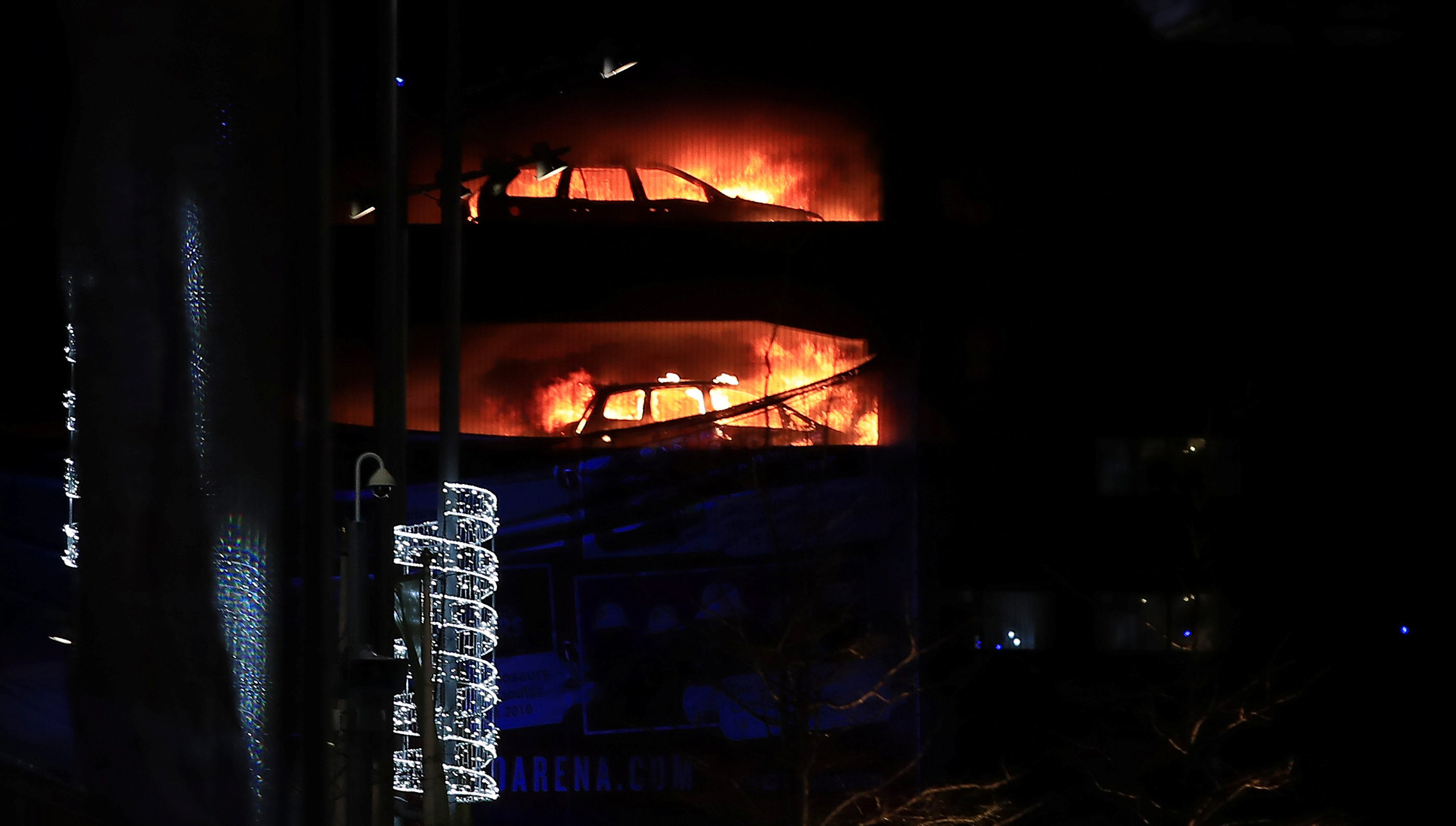 Cars are seen on fire during a serious blaze in a multi-storey car park in Liverpool, Britain, December 31, 2017. REUTERS/Phil Noble