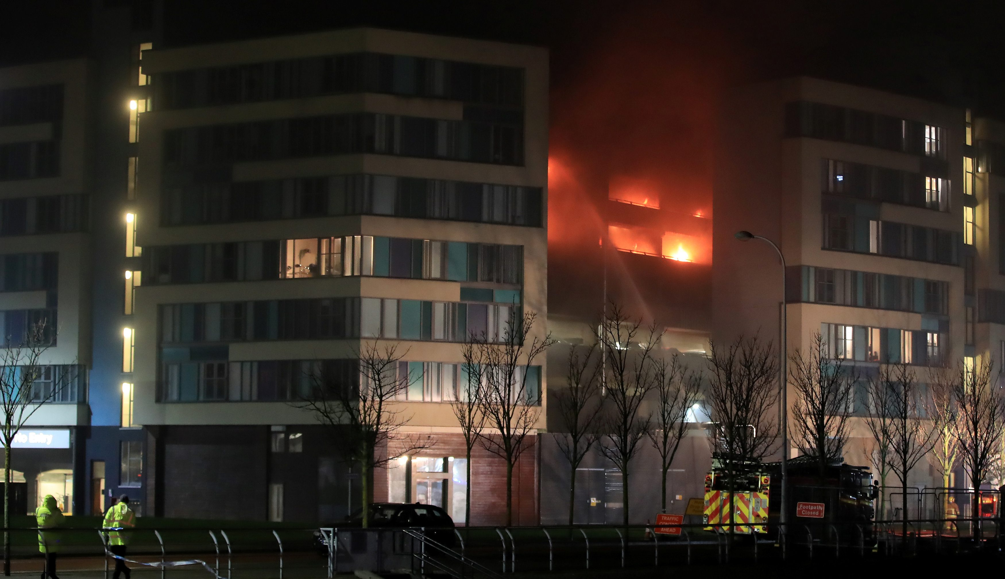 Firefighters tackle a fire during a serious blaze in a multi-storey car park in Liverpool, Britain, December 31, 2017. REUTERS/Phil Noble