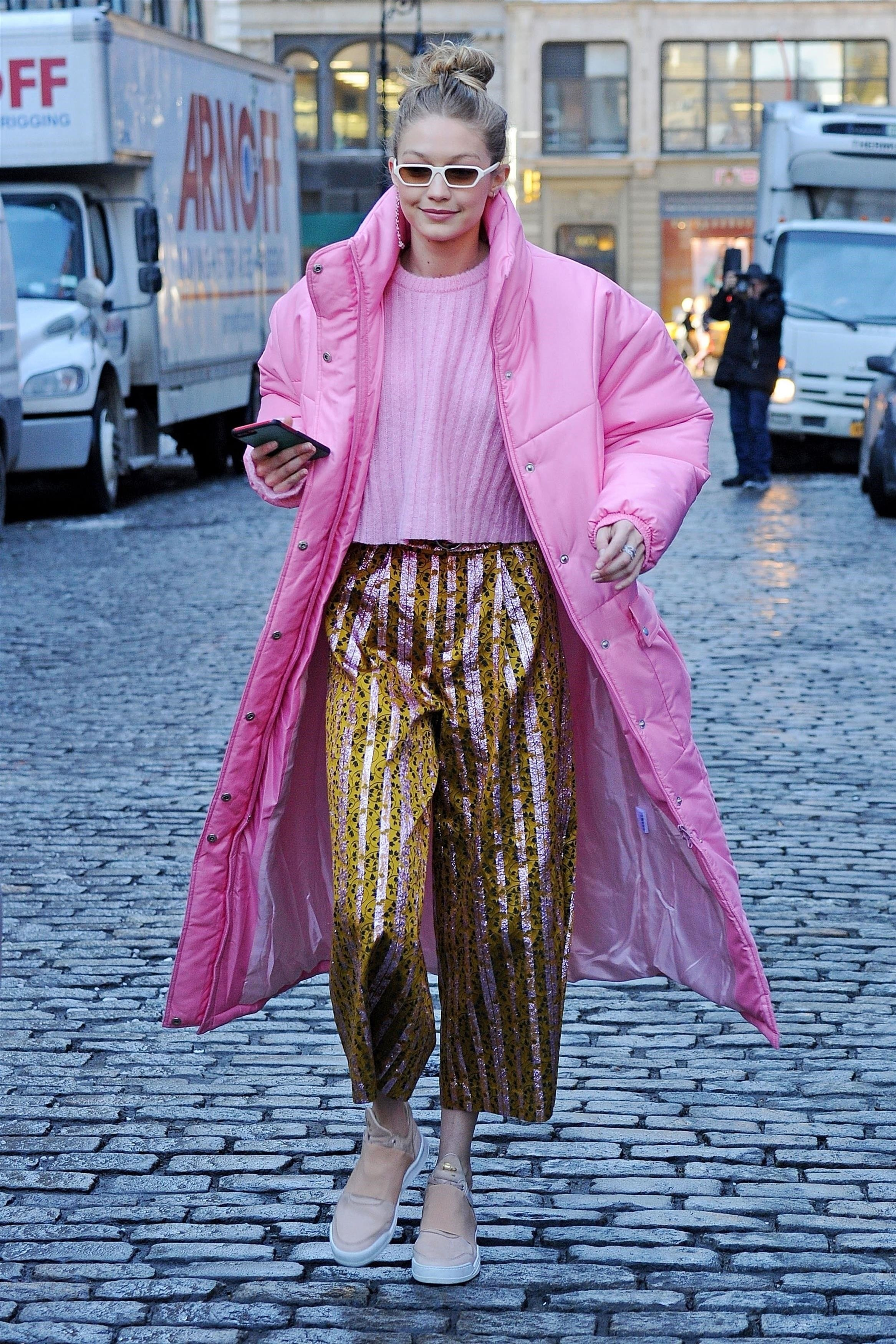 New York, NY  - Model Gigi Hadid steps out for French food for lunch at Little Prince in New York. Gigi was rocking a Pink puffy coat over a pink sweater and paired with gold striped pants.  Pictured: Gigi Hadid  BACKGRID USA 9 JANUARY 2018, Image: 359705399, License: Rights-managed, Restrictions: , Model Release: no, Credit line: Profimedia, AKM-GSI