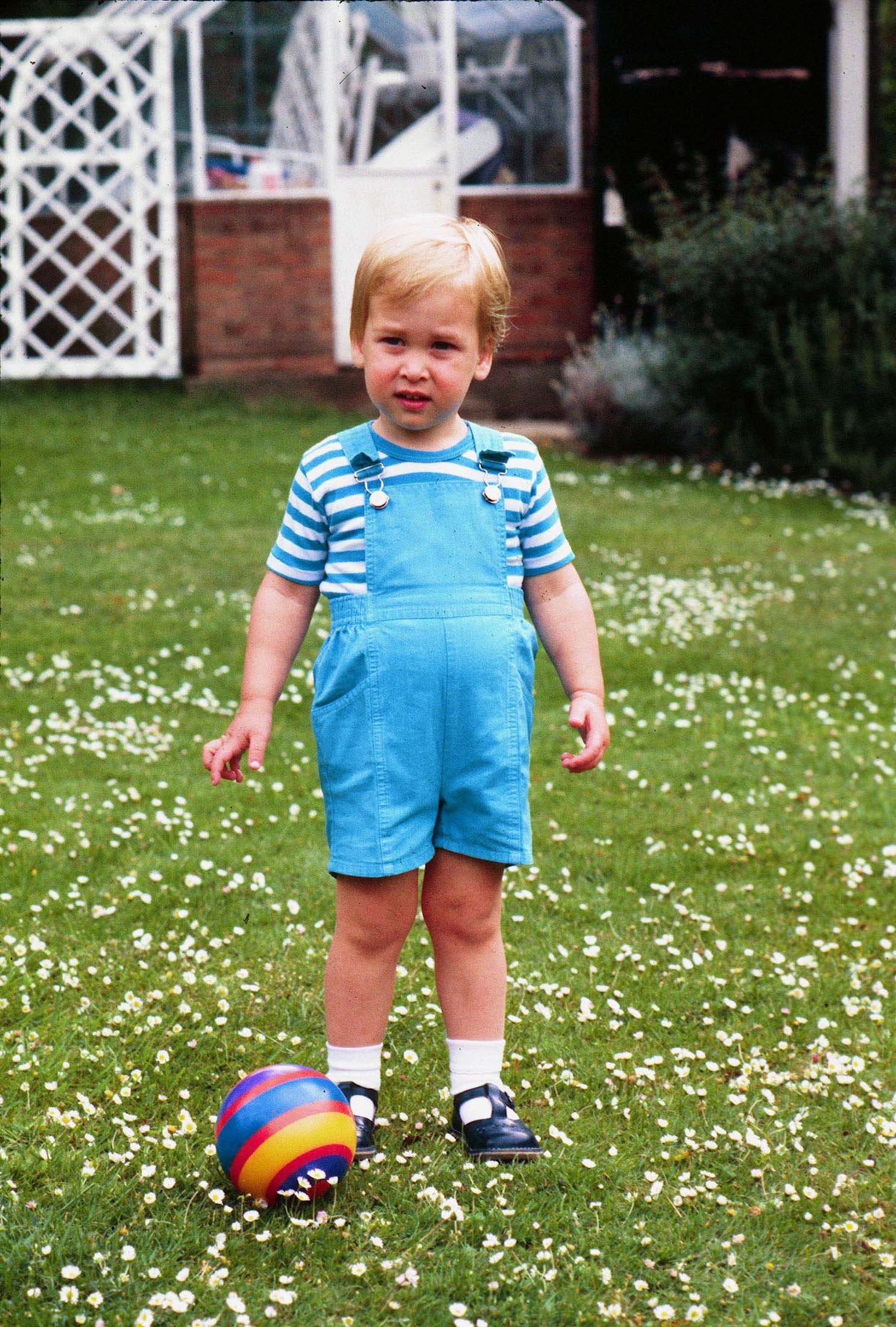 Prince William celebrates his 2nd Birthday by playing football in the gardens of Kensington Palace on June 21st, 1984. Prince Charles jokingly nicknamed his son 'wombat' during the photocall. Royals, William, Child, Sport, Casual, Full length ©Anwar Hussein/allaction.co.uk, Image: 105897877, License: Rights-managed, Restrictions: , Model Release: no, Credit line: Profimedia, Press Association