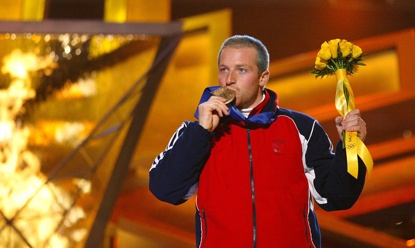 Olympic men's slalom bronze medalist Alain Baxter of Britain kisses his medal in front of the Olympic flame during medal ceremonies at the Salt Lake 2002 Winter Olympic Games, February 23, 2002. Jean-Pierre Vidal of France won Olympic gold in the slalom on Saturday ahead of silver medalist Sebastien Amiez of France and bronze medalist Baxter. REUTERS/Jim Bourg  KM/HB - RP3DRHYMMOAB