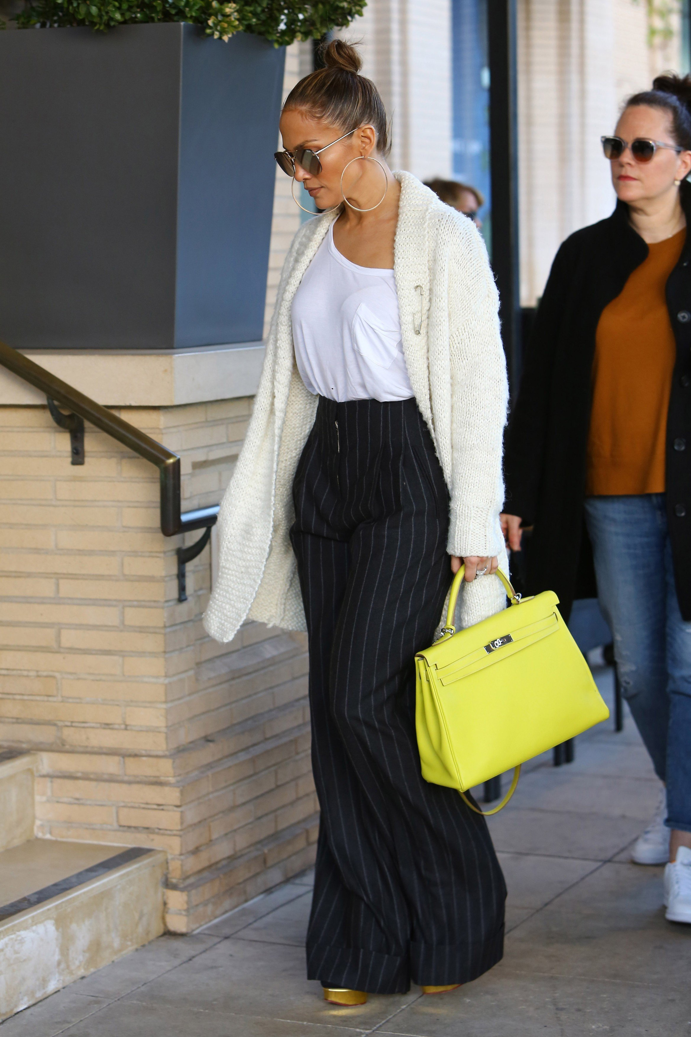 Beverly Hills, CA - Jennifer Lopez steps out with her girlfriends and does a little shopping at luxury jewelry store XIV Karats and later Barneys New York. The mother of two just posted a cryptic photo of Drake and herself cuddling last night, causing a slew internet chatter on their relationship status. Despite JLo claiming the two are just friends and working on music, she sure know how to build up the buzz.      December 28, 2016, Image: 309621225, License: Rights-managed, Restrictions: , Model Release: no, Credit line: Profimedia, AKM-GSI