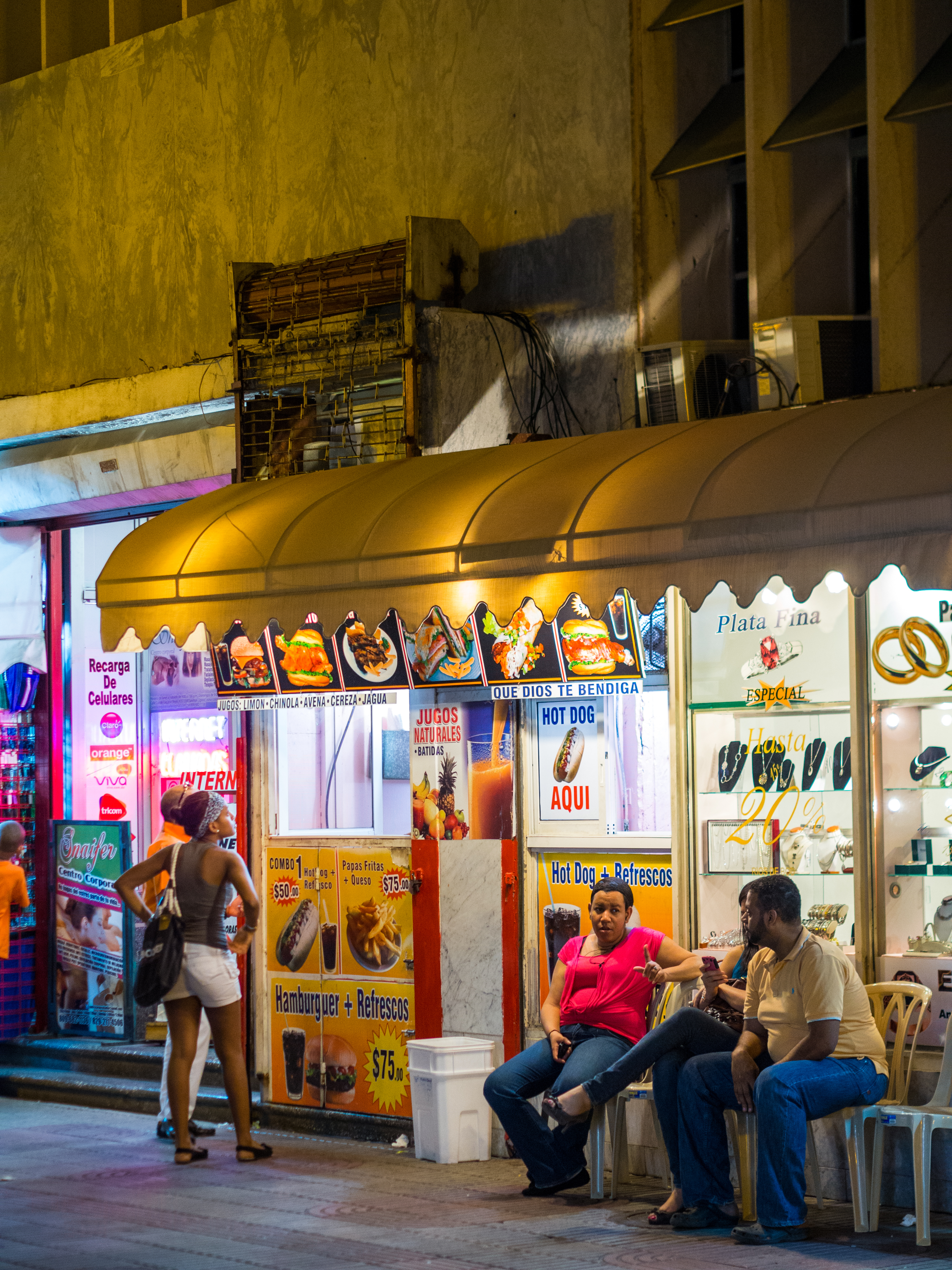 Santo Domingo, Dominican Republic - February 23, 2013: People enjoy the early hours of the evening at a basic street side cafe in the Zona Colonial or historical district of Santo Domingo.