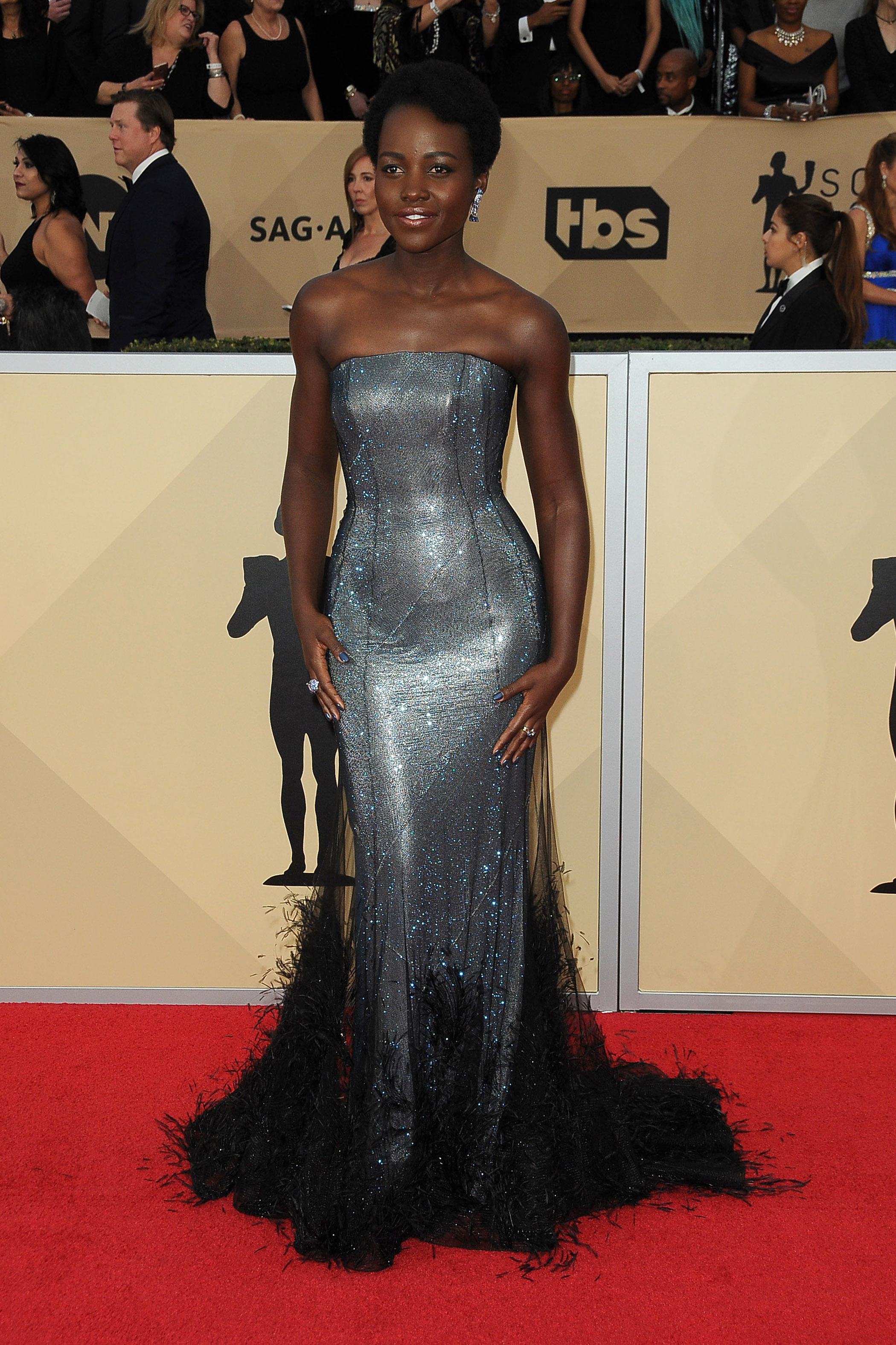 Arrivals for the 24th Annual Screen Actors Guild Awards, held at the Shrine Exposition Center in Los Angeles, California <P> Pictured: Lupita Nyongo <B>Ref: SPL1649120  210118  </B><BR/> Picture by: Splash News<BR/> </P><P> <B>Splash News and Pictures</B><BR/> Los Angeles:	310-821-2666<BR/> New York:	212-619-2666<BR/> London:	870-934-2666<BR/> <span id=