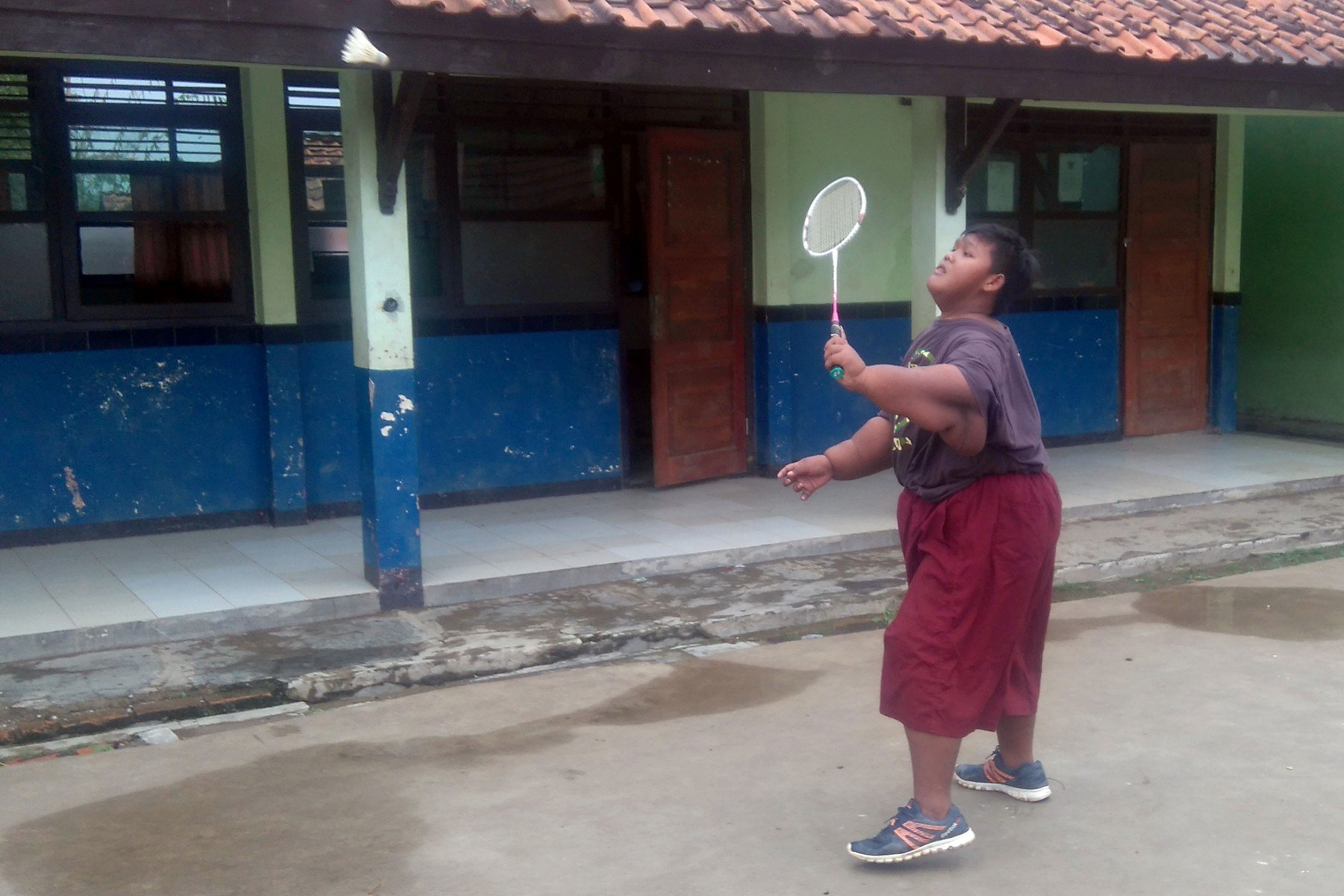 (PICTURED: Arya Permana,12, from boy from West Java Province, Indonesia, playing badminton) -  Arya Permana, the worlds fattest boy who was so obese to not even move on his own has remarkably shed 167 pounds and now plays badmintonlikean ace. At 30st 23lbs, the thenten-year-old Indonesian boy was so severely big for his age that he could not move on his own, let alone walk, sit or play.Aryasever-growing giant frame meant that no garment fit him and he was mostly draped in a sarong.He never attended classes as walking to the school was an uphill task for him., Image: 361179068, License: Rights-managed, Restrictions: , Model Release: no, Credit line: Profimedia, Caters News
