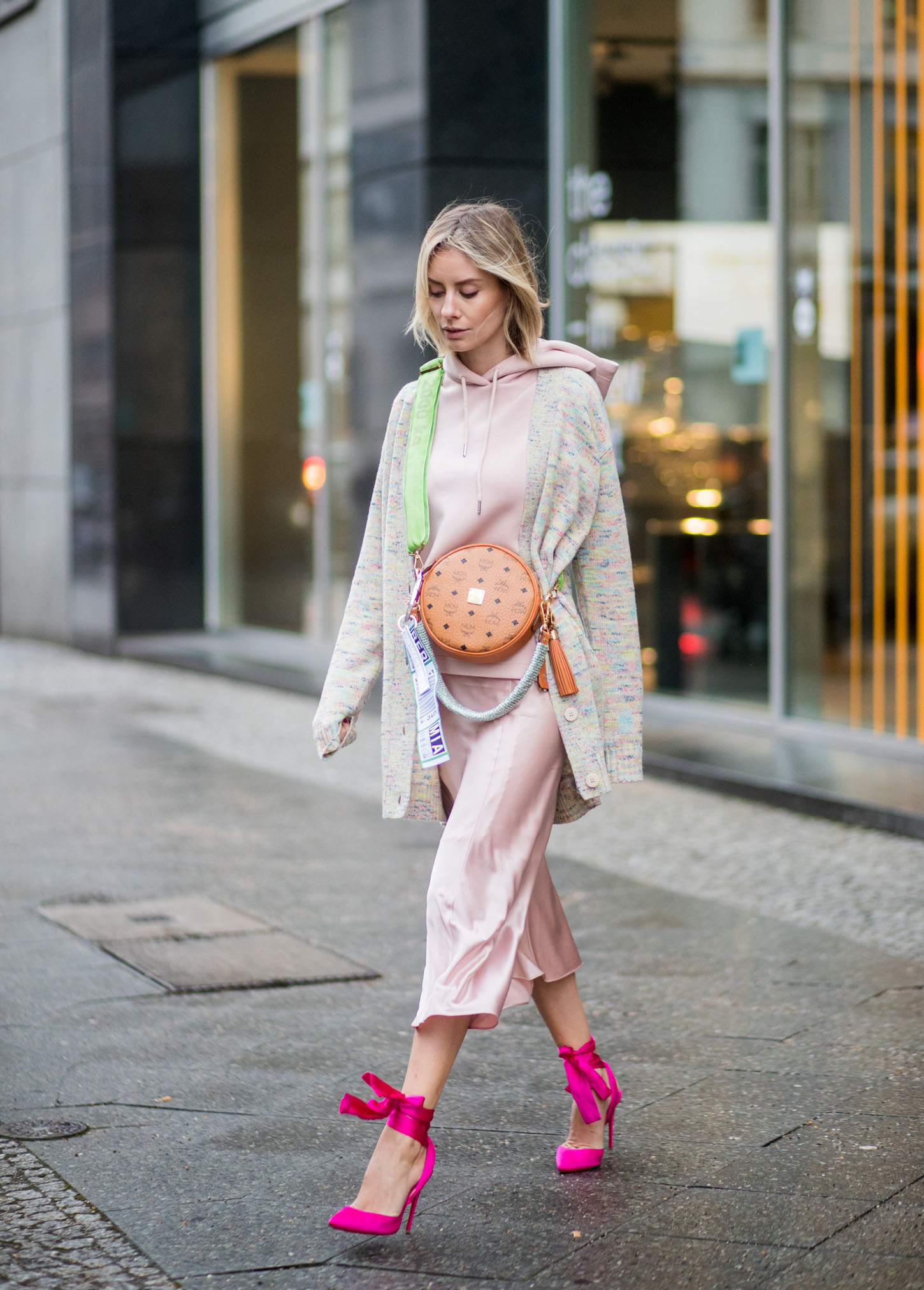 BERLIN, GERMANY - JANUARY 17: Lisa Hahnbueck wearing MCM x Koenigsouvenir bag, pink heels, rose dress, coat is seen outside Lana Mueller during the Berlin Fashion Week January 2018 on January 17, 2018 in Berlin, Germany. (Photo by Christian Vierig/Getty Images)