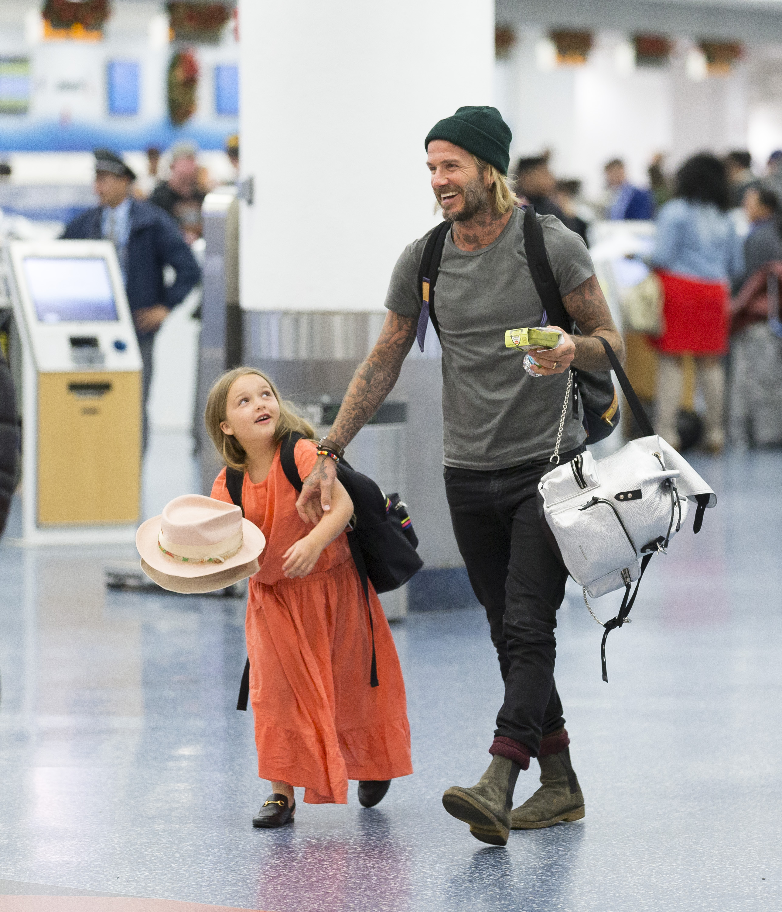 EXCLUSIVE: **PREMIUM EXCLUSIVE RATES APPLY**NO WEB UNTIL 2PM GMT SATURDAY JAN 6, 2018** David and Victoria Beckham and their four children were spotted checking into a flight at Miami airport after enjoying a luxurious Caribbean holiday. The Beckhams arrived in Miami two hours earlier on a private jet after a New Years break at an exclusive beachfront resort in the Turks and Caicos islands. David, 42, held hands and laughed with his cute daughter Harper, 6, as they transferred to a commercial flight after making a quick stop at the famous Cuban restaurant Versailles. Airport TSA security officers were delighted as they posed for selfies with the ex-footballer as the famous family - including sons Brooklyn, Romeo and Cruz - made their way through security screening. Little Harper proved she's a budding fashionista by wearing £235 Gucci Princetown slippers. Her fashion designer mother Victoria, 43, hid behind her trademark dark sunglasses and didn't get involved in taking selfies with staff. <P> Pictured: David Beckham, Harper <B>Ref: SPL1641864  050118   EXCLUSIVE</B><BR/> Picture by: Splash News<BR/> </P><P> <B>Splash News and Pictures</B><BR/> Los Angeles:310-821-2666<BR/> New York:212-619-2666<BR/> London:870-934-2666<BR/> <span id=