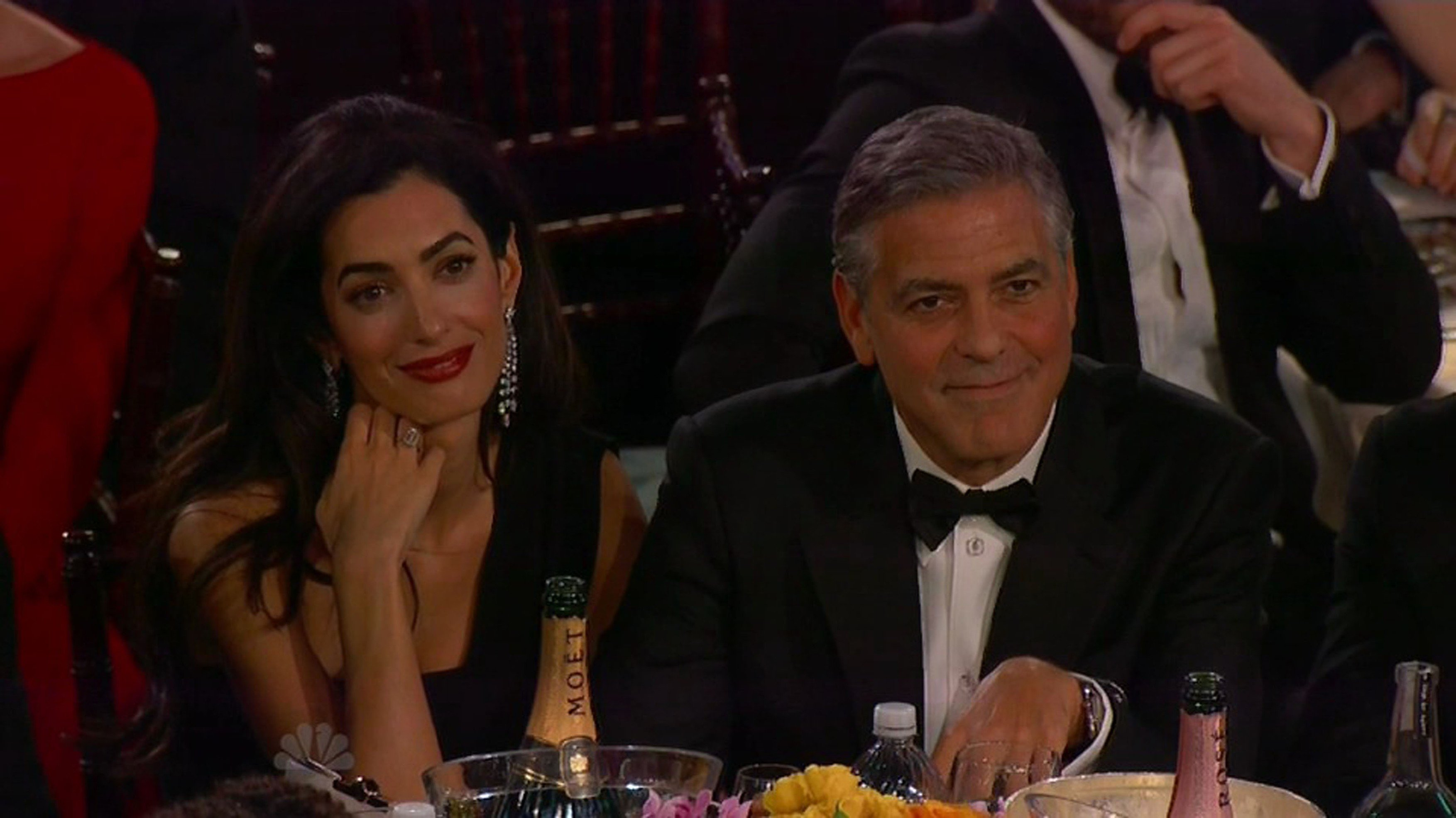 12 January 2015 - Los Angeles - USA  **** STRICTLY NOT AVAILABLE FOR USA ***  Amal Clooney caught out chatting and not paying attention during Golden Globe tribute to new husband George Clooney. The award ceremony novice was caught on camera paying attention as Julianna Margulies and Don Cheadle honoured George  with the Cecil B DeMille Lifetime Achievement Award at the Golden Globes in Los Angeles. As the actors said their rather long speech, the British lawyer had a little chat to her table mate Bill Murray not realising the camera was on her. Looking away from the stage to face Bill, Amal suddenly became aware that all eyes were on her and quickly turned back on the charm smiling sweetly at the camera. She then spent the rest of the tribute either smiling at the cameras or looking lovingly and Clooney by her side., Image: 215154048, License: Rights-managed, Restrictions: PLEASE CREDIT AS PER BYLINE *UK CLIENTS - PLEASE PIXELATE CHILDS FACE BEFORE PUBLICATION **UK CLIENTS MUST CALL PRIOR TO TV OR ONLINE USAGE, Model Release: no, Credit line: Profimedia, Xposurephotos