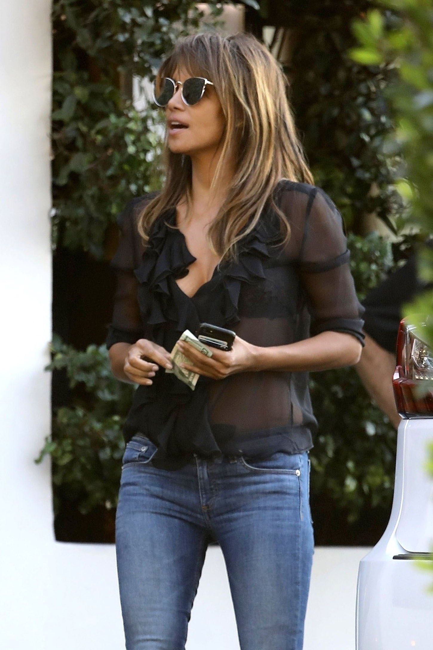 West Hollywood, CA  - *EXCLUSIVE*  - A bubbly Halle Berry chats with her friends at valet after having lunch this afternoon at Cecconi's.  Halle wore a sexy sheer top for today's lunch which had her older male friend take a few double looks at her to bring a big smile to her face.  Pictured: Halle Berry  BACKGRID USA 4 JANUARY 2018, Image: 359242925, License: Rights-managed, Restrictions: , Model Release: no, Credit line: Profimedia, AKM-GSI