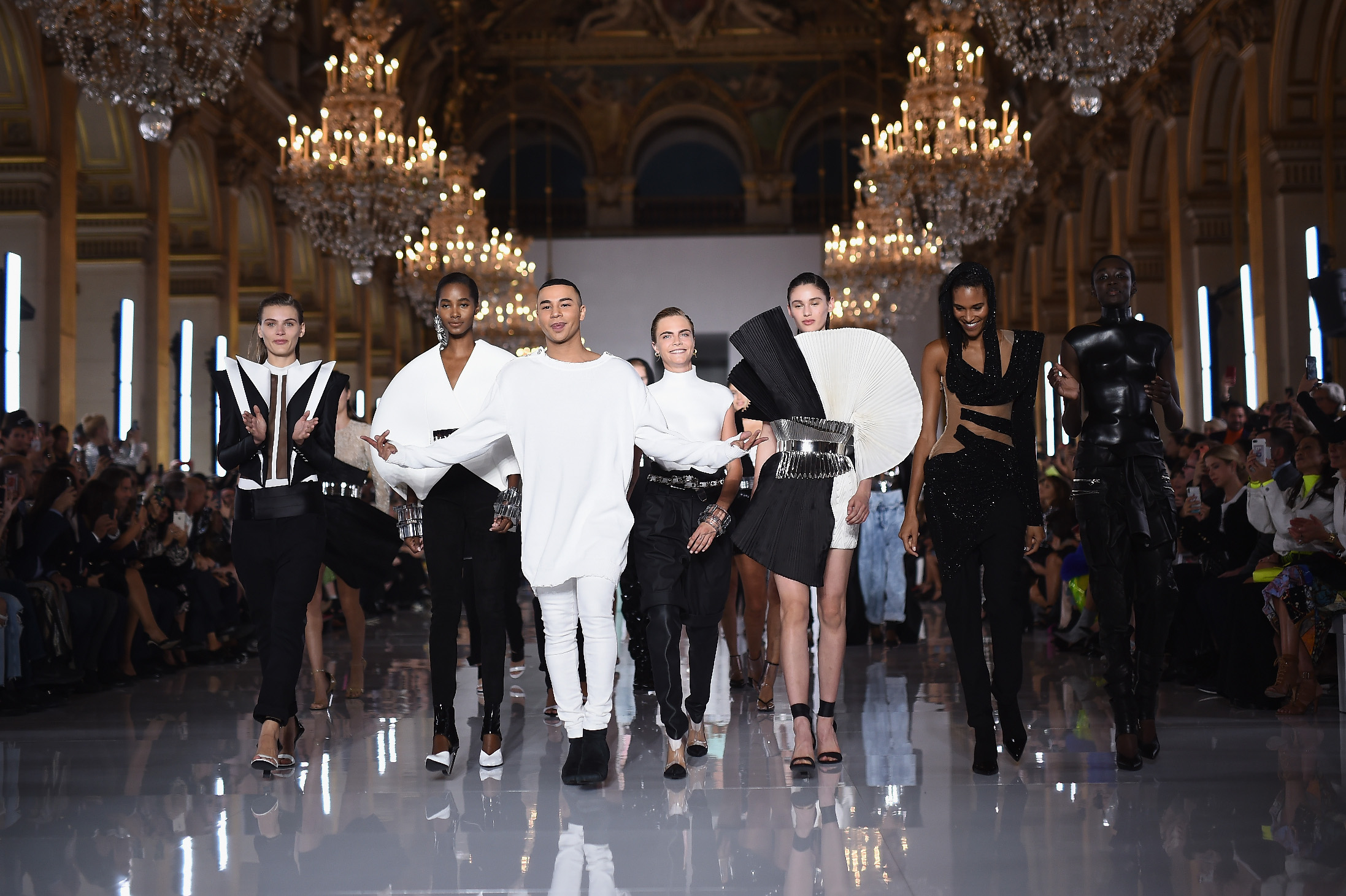 PARIS, FRANCE - SEPTEMBER 28:  Olivier Rousteing (C) is applauded on the runway during the Balmain show as part of the Paris Fashion Week Womenswear Spring/Summer 2019 on September 28, 2018 in Paris, France.  (Photo by Pascal Le Segretain/Getty Images)