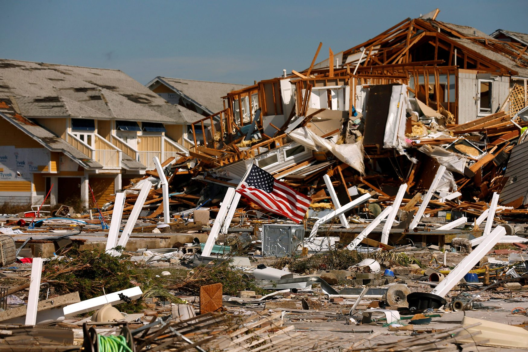 An American flag flies amongst rubble left in the aftermath of Hurricane Michael in Mexico Beach, Florida, U.S. October 11, 2018. REUTERS/Jonathan Bachman     TPX IMAGES OF THE DAY