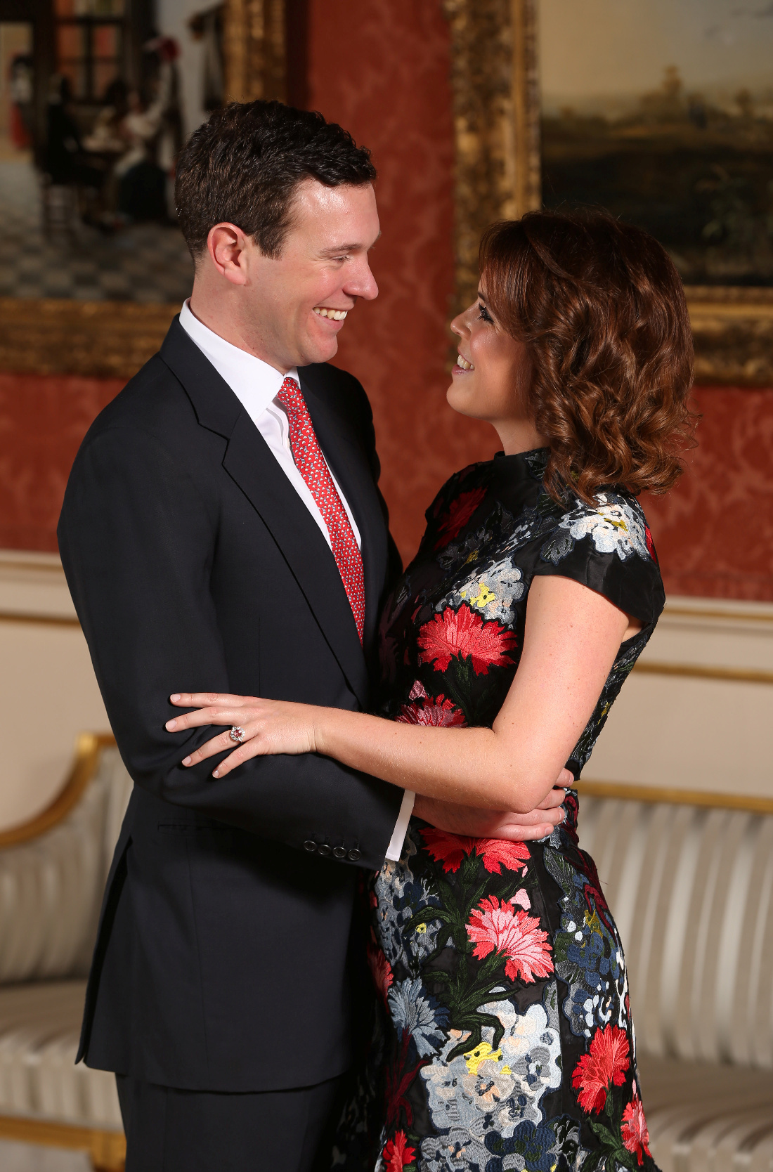 Britain's Princess Eugenie and Jack Brooksbank pose in the Picture Gallery after they announced their engagement, at Buckingham Palace, London January 22, 2018. REUTERS/Jonathan Brady/Pool - RC1D9187F800