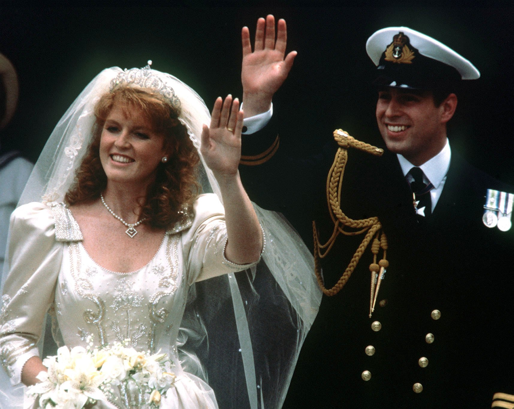 """File photo dated 23/07/1986 of Prince Andrew and his bride Sarah Ferguson waving to crowds as they leave Westminster Abbey, London after their wedding ceremony. When Princess Eugenie's parents married, Britain was in the grip of """"Fergie Fever""""., Image: 390117510, License: Rights-managed, Restrictions: FILE PHOTO, Model Release: no, Credit line: Profimedia, Press Association"""