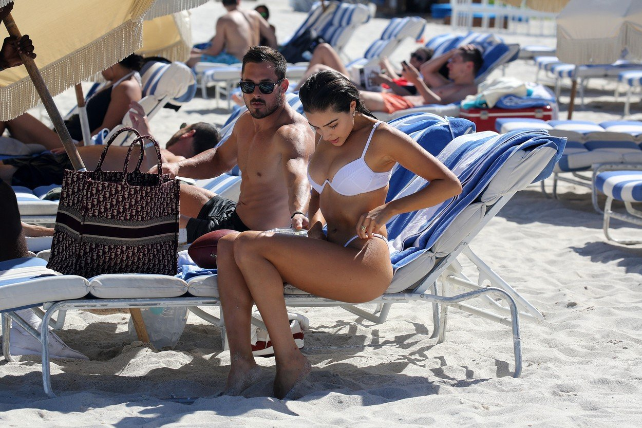 Bikini clad model Olivia Culpo and NFL player Danny Amendola are clearly back together as they hold hands  on the beach in Miami. The model looked amazing in a white bikini as she and her Dolphin's player love were seen going for a swim to cool off. 25 Sep 2018, Image: 388374267, License: Rights-managed, Restrictions: World Rights, Model Release: no, Credit line: Profimedia, Mega Agency