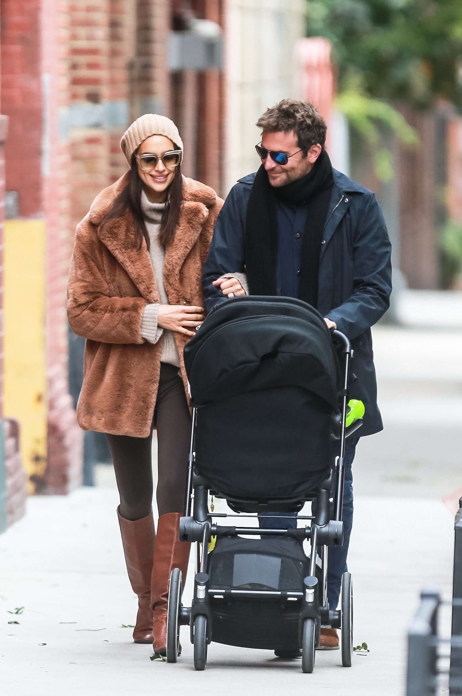 New York, NY  - Bradley Cooper and Irina Shayk enjoying their Sunday with their daughter Lea at a playground. The family look happy as they enjoy their brisk NYC morning together.  Pictured: Bradley Cooper, Irina Shayk    *UK Clients - Pictures Containing Children Please Pixelate Face Prior To Publication*, Image: 392016501, License: Rights-managed, Restrictions: , Model Release: no, Credit line: Profimedia, AKM-GSI