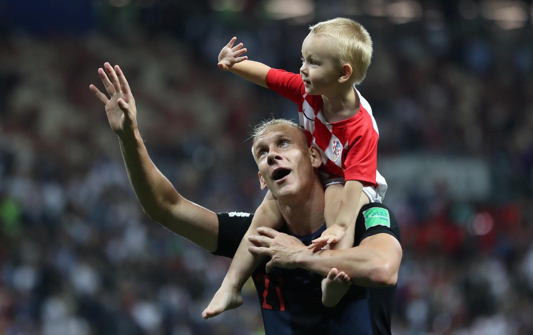 Soccer Football - World Cup - Semi Final - Croatia v England - Luzhniki Stadium, Moscow, Russia - July 11, 2018  Croatia's Domagoj Vida celebrates with child after the match   REUTERS/Carl Recine - RC1B72A93280