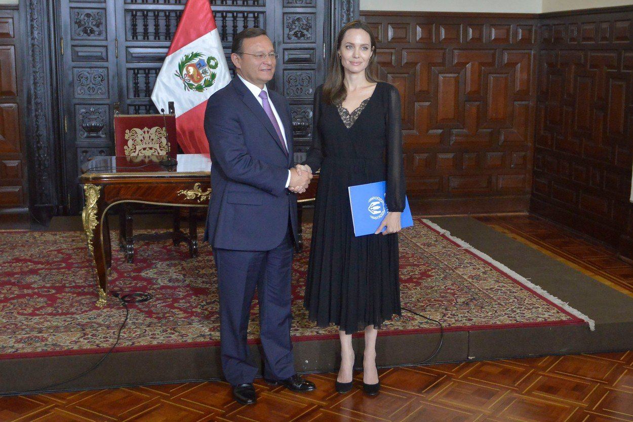 Photo © 2018 Diario Republica de Peru/The Grosby Group  Lima, Peru Oct 23, 2018  Angelina Jolie visits Peru to help the Venezuelan refugees and joins the Peruvian Foreign Minister, Nestor Popolizio, during a press conference al the Palacio de Gobierno in Lima., Image: 392355982, License: Rights-managed, Restrictions: , Model Release: no, Credit line: Profimedia, Grosby Group