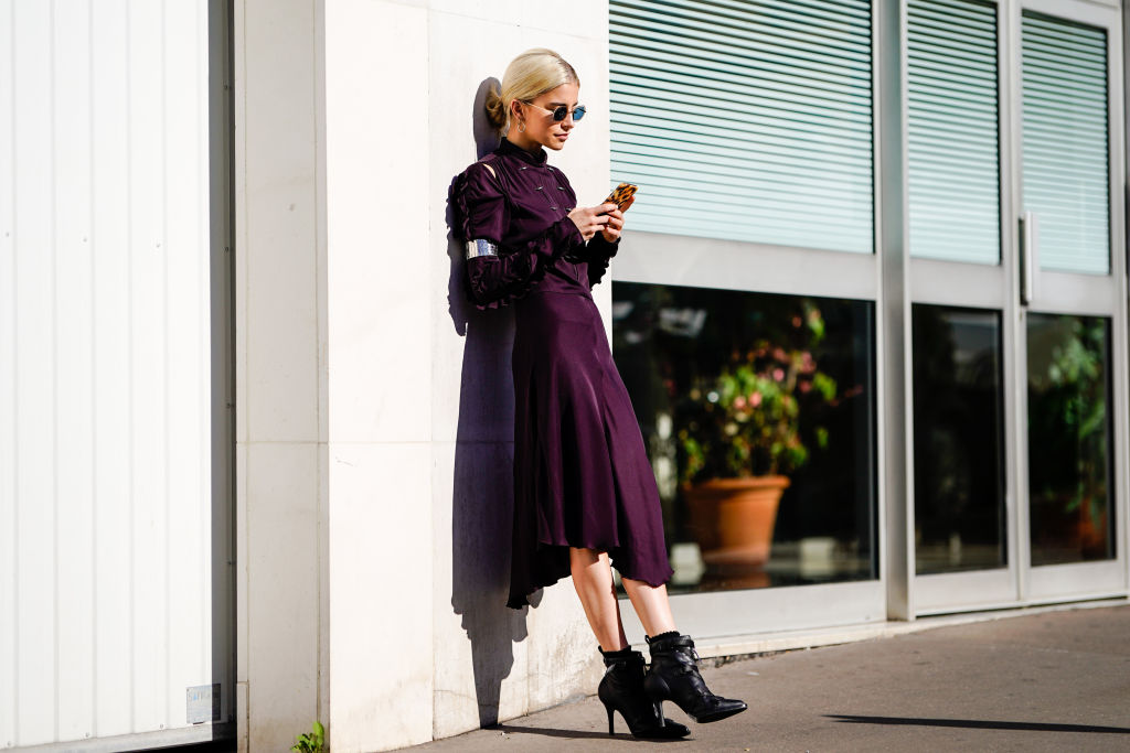 PARIS, FRANCE - SEPTEMBER 27:  Caroline Daur wears a purple dress and sunglasses, outside Chloe, during Paris Fashion Week Womenswear Spring/Summer 2019, on September 27, 2018 in Paris, France.  (Photo by Edward Berthelot/Getty Images)