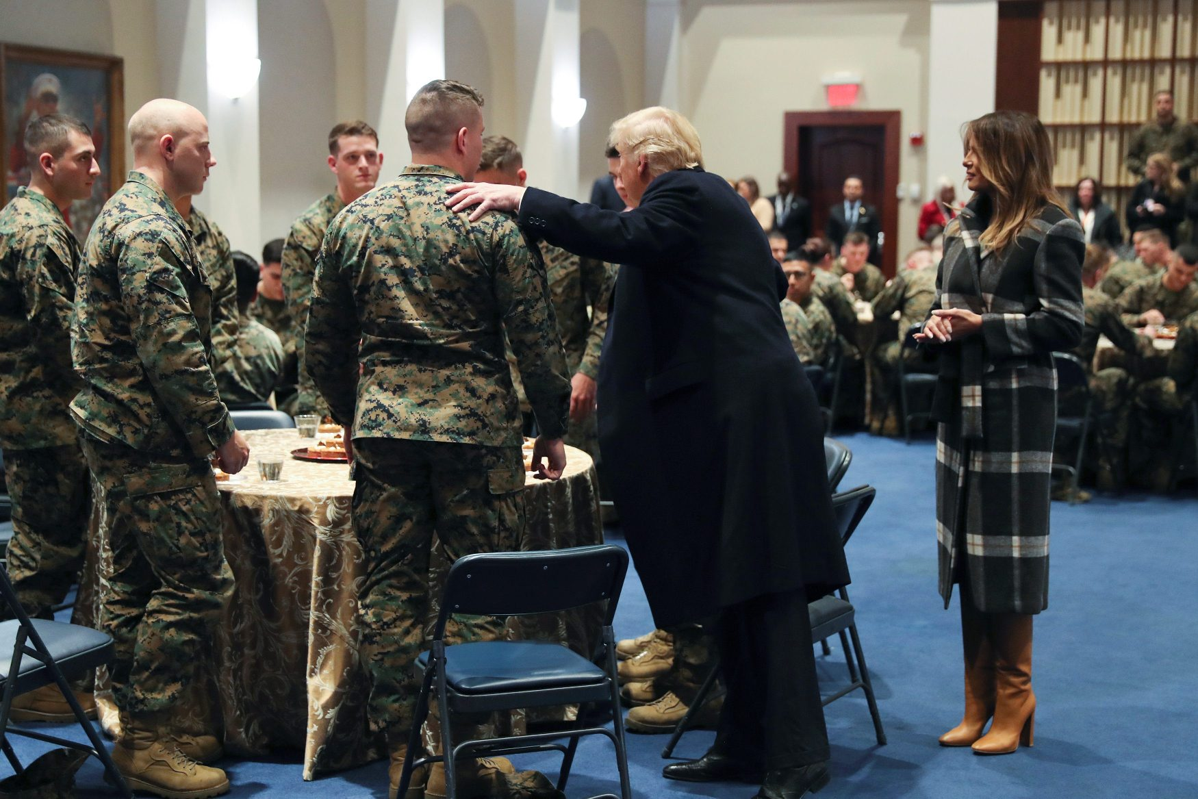 U.S. President Donald Trump and first lady Melania Trump visit U.S. Marines at the Marine Corps Barracks in Washington, U.S. November 15, 2018. REUTERS/Jonathan Ernst