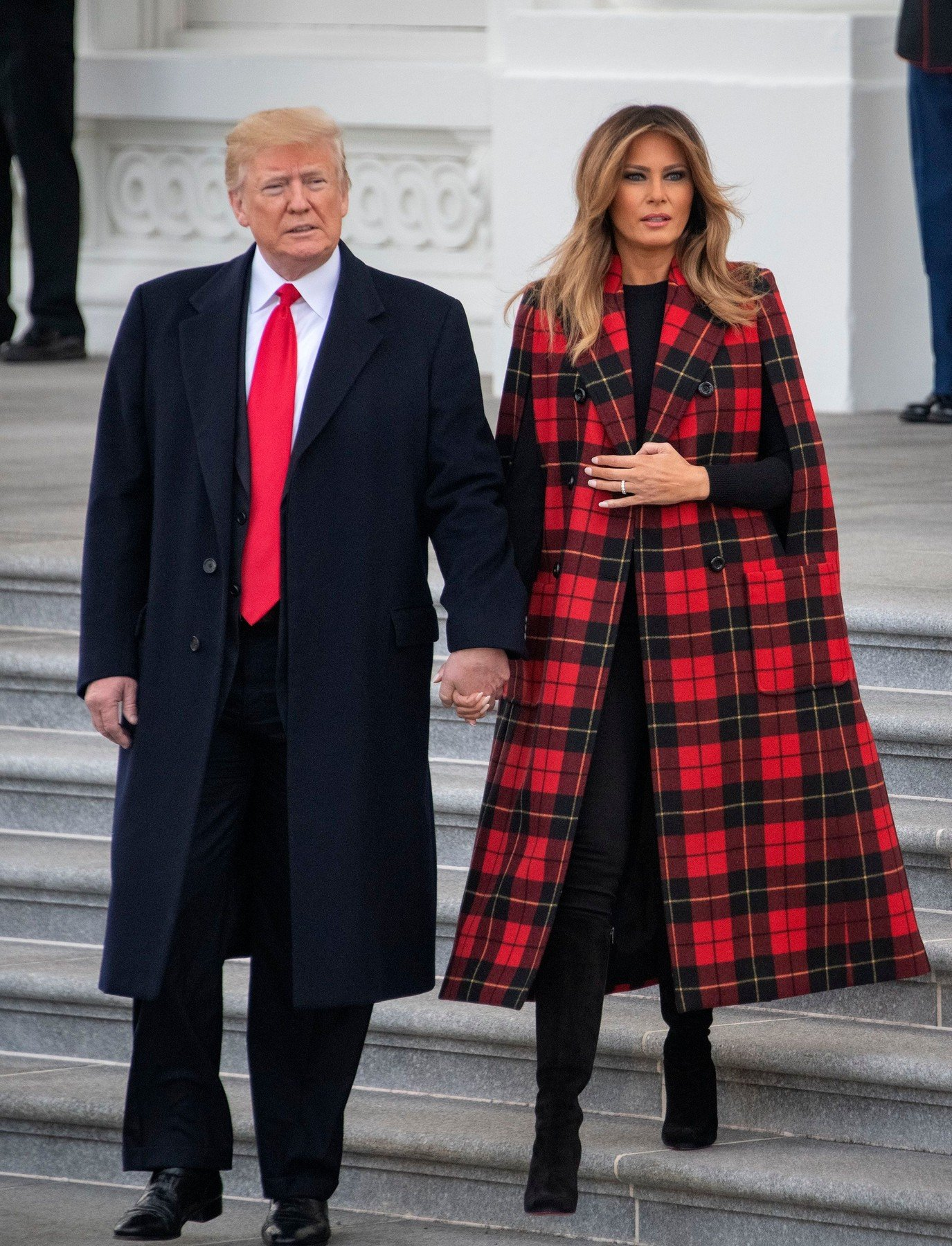 United States President Donald J. Trump and First lady Melania Trump walk out of the North Portico to accept the White House Christmas tree on the North Driveway of the White House in Washington, DC. The 2018 White House Christmas Tree will arrive as in previous years by horse and carriage on the North Portico. The tree will be displayed in the Blue Room of the White House. White House Christmas Tree Arrives, Washington DC, USA - 19 Nov 2018, Image: 397378304, License: Rights-managed, Restrictions: No New York or New Jersey Newspapers or newspapers within a 75 mile radius of New York City, Model Release: no, Credit line: Profimedia, TEMP Rex Features