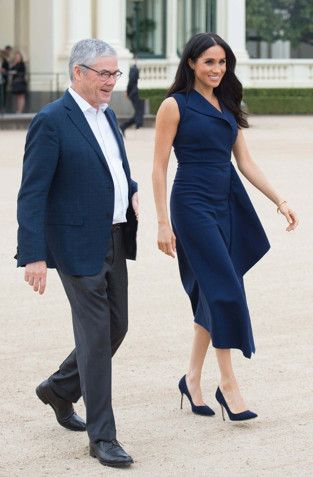 Prince Harry, the Duke of Sussex and Meghan, the Duchess of Sussex attend a Reception hosted by the Honourable Linda Dessau AC, Governor of Victoria and Mr. Anthony Howard QC at Government House Victoria in Melbourne.  Dress ? Dion Lee Shoes ? Manolo Blahnik BB stilettos ?556  Pictured: Meghan,the Duchess of Sussex and Anthony Howard Ref: SPL5034243 181018 NON-EXCLUSIVE Picture by: SplashNews.com  Splash News and Pictures Los Angeles: 310-821-2666 New York: 212-619-2666 London: 0207 644 7656 Milan: 02 4399 8577 photodesk@splashnews.com  World Rights