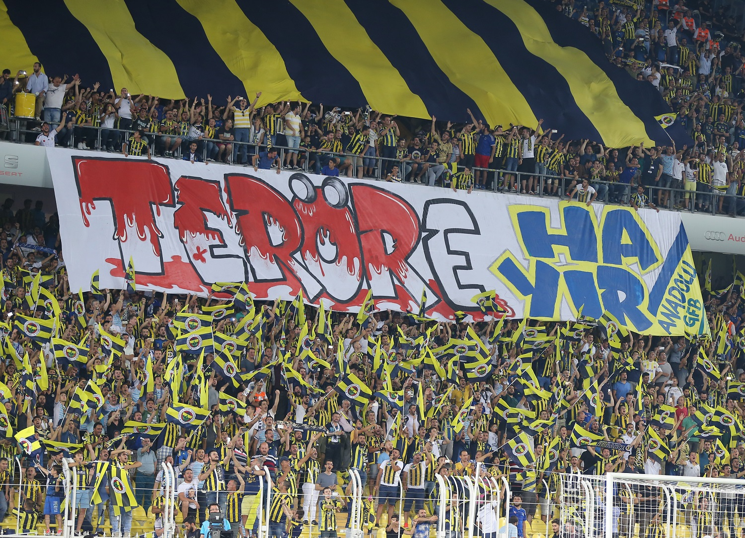 ISTANBUL, TURKEY -  JULY 28: Fenerbahce's supporters protest with a banner as written Turkish as