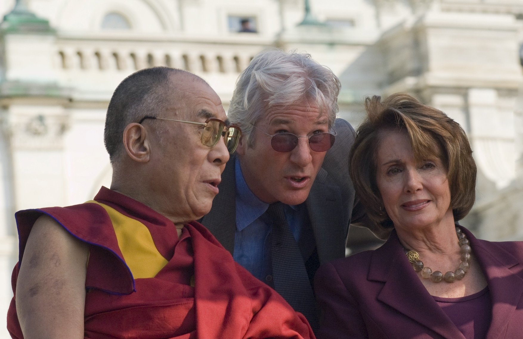 His Holiness, The Dalai Lama chats with actor Richard Gere and Speaker of the House, Nancy Pelosi, D-CA before addressing the crowd of supporters on the West front of the US Capital. The Dalai Lama was given the Congressional Medal of Freedom, the highest award that Congress bestows. The Dalai Lama given the Congressional Medal of Freedom, Washington DC, America - 17 Oct 2007   701751h, Image: 226415521, License: Rights-managed, Restrictions: , Model Release: no, Credit line: Profimedia, TEMP Rex Features
