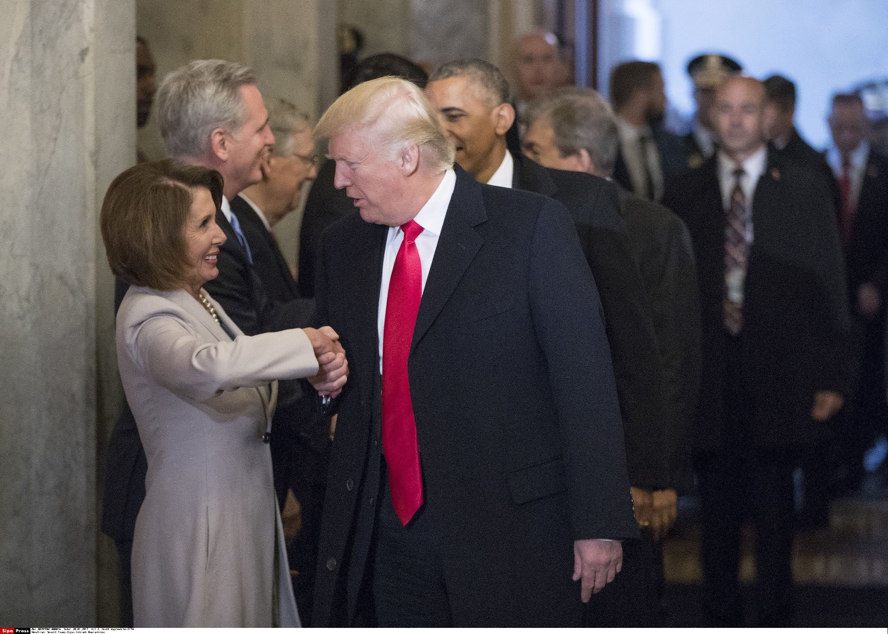 United States President-elect Donald Trump greets US House Minority Leader Nancy Pelosi (Democrat of California), and other Congressional leaders as he arrives for his inauguration ceremony on Capitol Hill in Washington, Friday, Jan. 20, 2017. Photo Credit: J. Scott Applewhite /CNP/AdMedia//ADMEDIA_adm_012017_Trump-Inaugural2_CNP_049/Credit:J. Scott Applewhite/SIPA/1701221841, Image: 312482229, License: Rights-managed, Restrictions: , Model Release: no, Credit line: Profimedia, TEMP Sipa Press