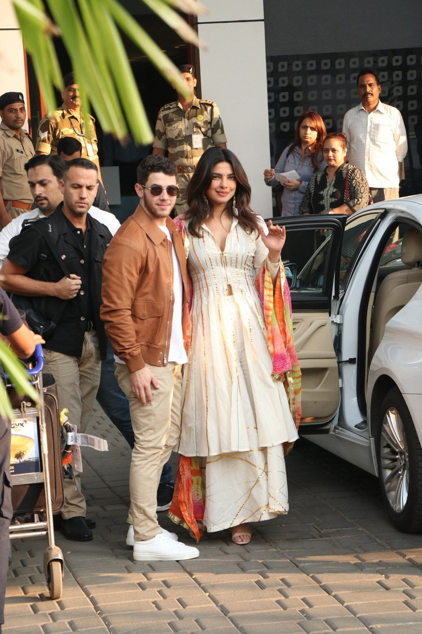 EXCLUSIVE: Priyanka Chopra and Nick Jonas are seen leaving Mumbai to head to Jodhpur for their wedding. His brother Joe and girlfriend actress Sophie Turner were also seen heading to the airport to join them. 29 Nov 2018, Image: 398986174, License: Rights-managed, Restrictions: World Rights, Model Release: no, Credit line: Profimedia, Mega Agency