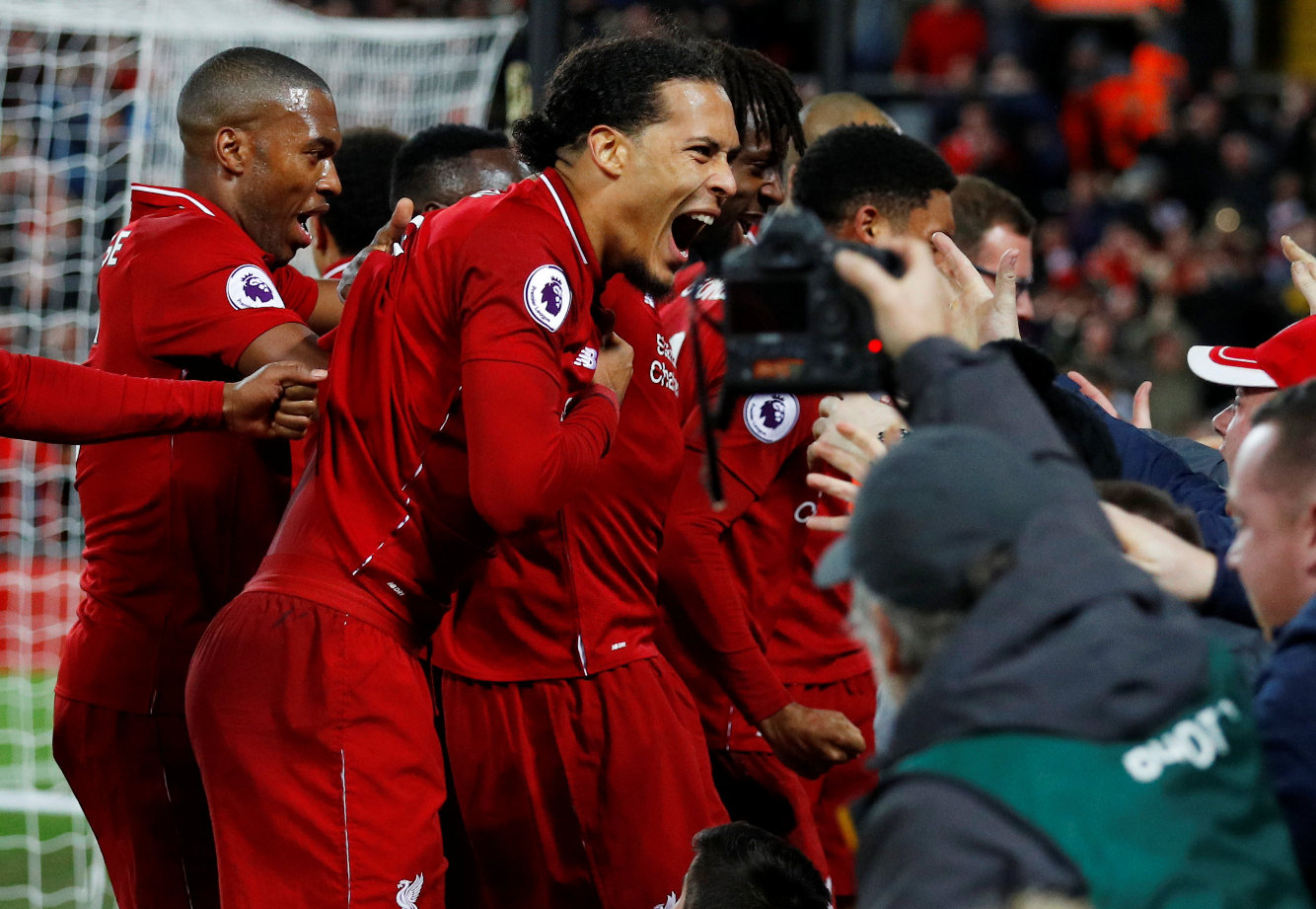 Soccer Football - Premier League - Liverpool v Everton - Anfield, Liverpool, Britain - December 2, 2018  Liverpool's Divock Origi celebrates scoring their first goal with Virgil van Dijk and team mates  REUTERS/Phil Noble  EDITORIAL USE ONLY. No use with unauthorized audio, video, data, fixture lists, club/league logos or