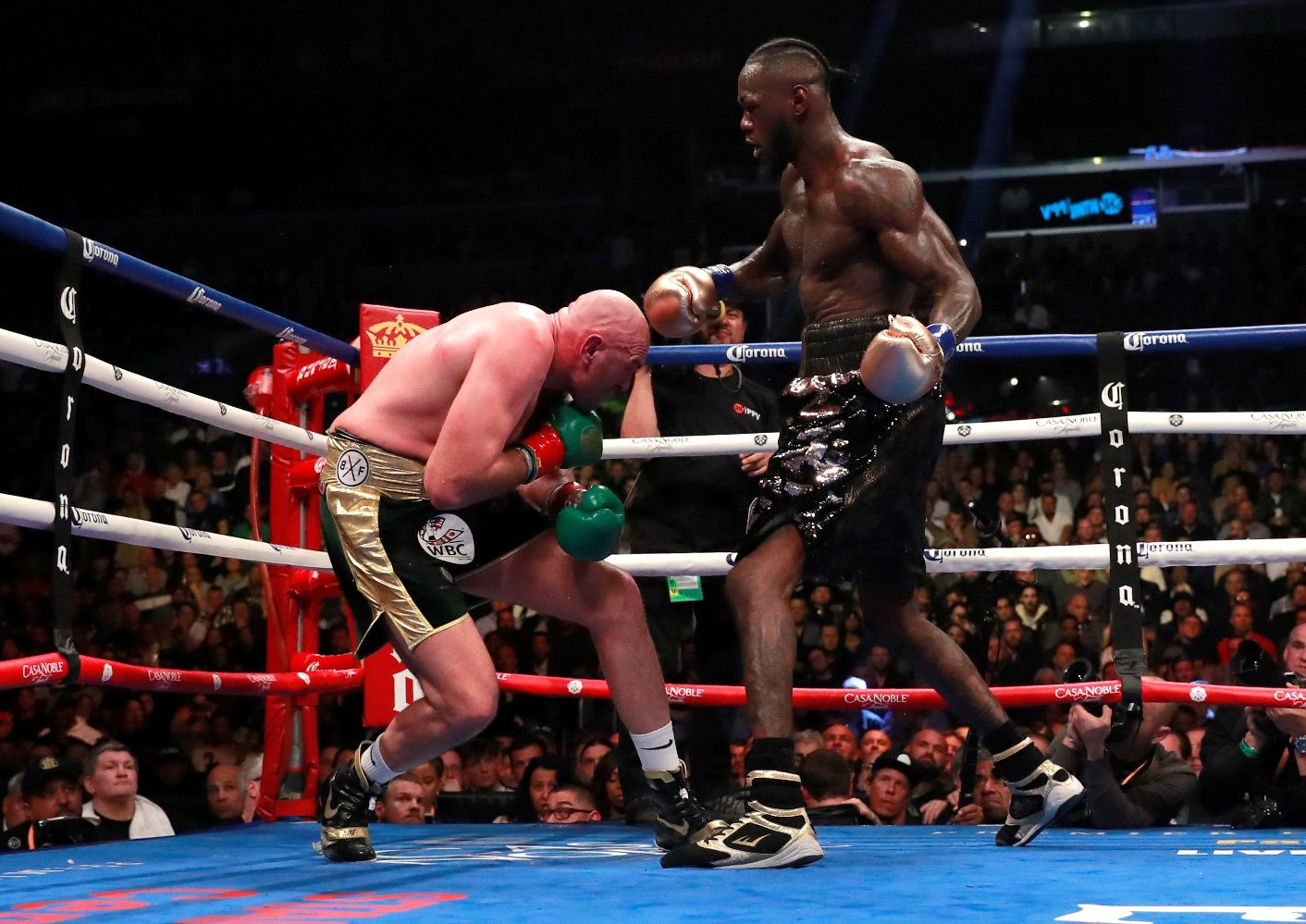 Boxing - Deontay Wilder v Tyson Fury - WBC World Heavyweight Title - Staples Centre, Los Angeles, United States - December 1, 2018  Deontay Wilder knocks down Tyson Fury   Action Images via Reuters/Andrew Couldridge