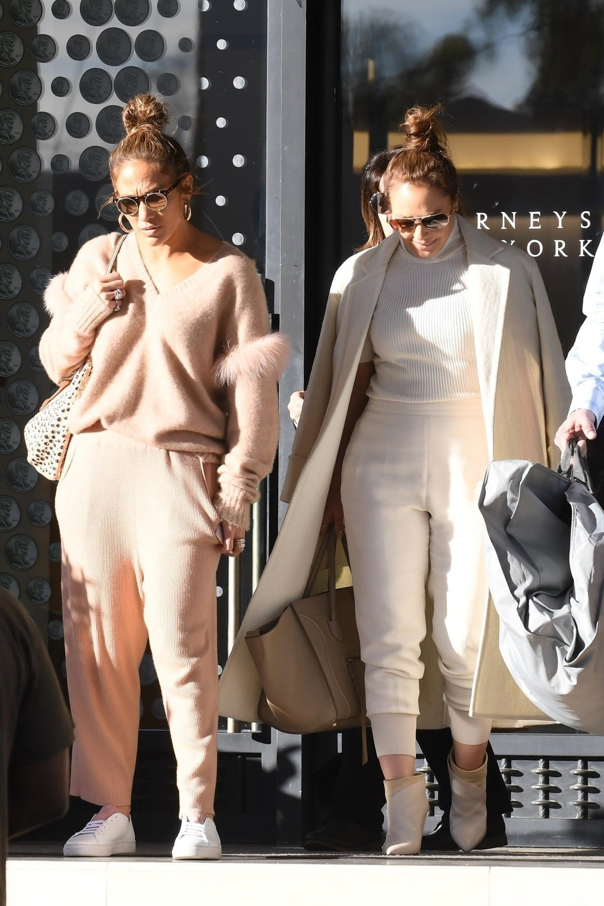 Los Angeles, CA  - Jennifer Lopez and BFF Leah Remini pose for a selfie with a fan while exiting Barneys New York this afternoon during a holiday shopping outing together. Leah grabs JLo's arm as she carefully goes down the stairs in her heels.  Pictured: Jennifer Lopez  BACKGRID USA 20 DECEMBER 2018, Image: 403705338, License: Rights-managed, Restrictions: , Model Release: no, Credit line: Profimedia, AKM-GSI