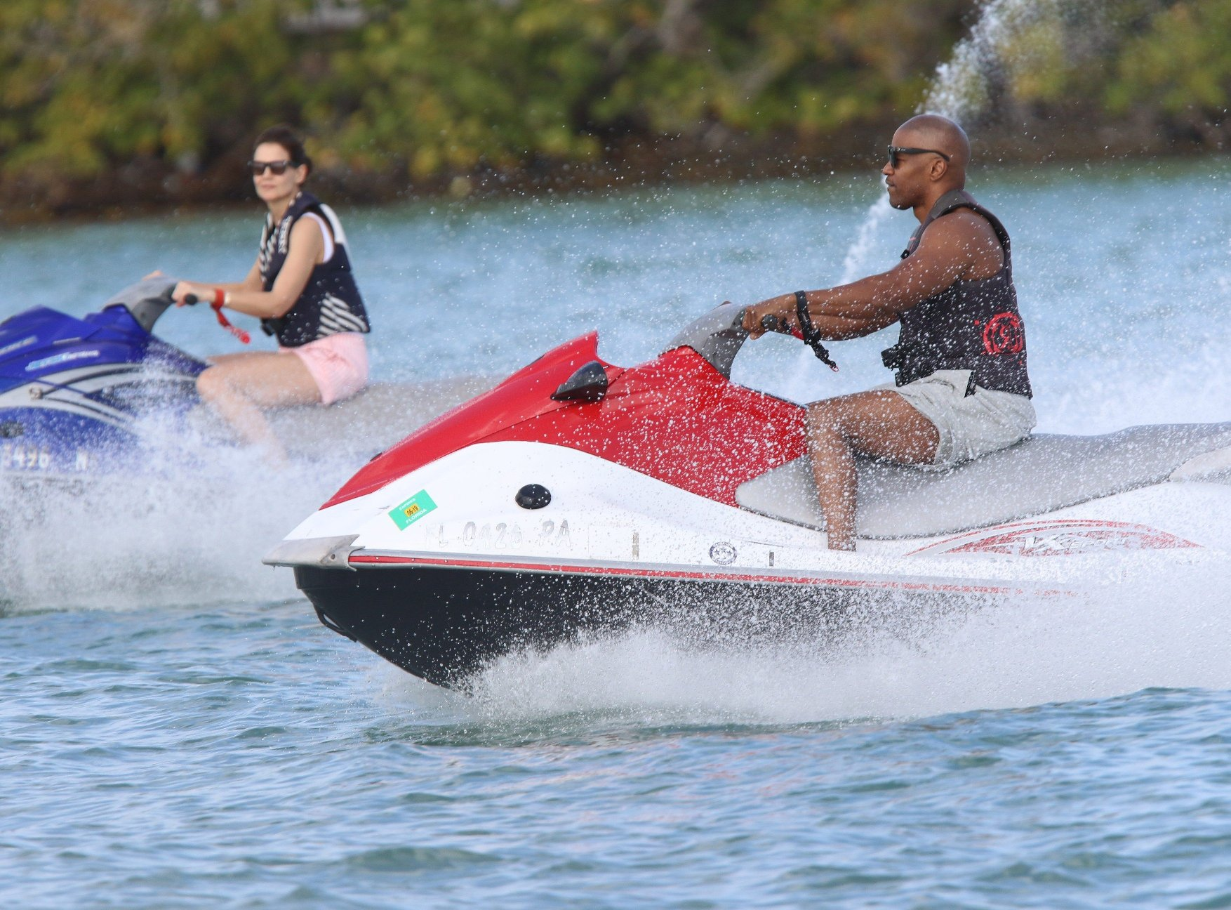 *PREMIUM EXCLUSIVE* Lovebirds Katie Holmes and Jamie Foxx revved up their romantic Miami vacation with a jet ski ride over the weekend. The A-list duo hit the pristine waters of Biscayne Bay on the second day of their sundrenched New Years break. These days, the Dawsons Creek actress and her R&B singer beau are leaving no room for doubt over their love affair, which has been kept out of the spotlight for years in one of Hollywood's worst kept showbiz secrets. On Saturday (dec 29) they threw caution to the wind as they lounged around on an  million superyacht and raced each other on red and blue jet skis. Katie, who turned 40 earlier this month, sported a huge grin and flashed her shapely pins in a pair of flirty striped shorts. MANDATORY BYLINE :  Splash News/MEGA. 29 Dec 2018, Image: 404762028, License: Rights-managed, Restrictions: World Rights, Model Release: no, Credit line: Profimedia, Mega Agency