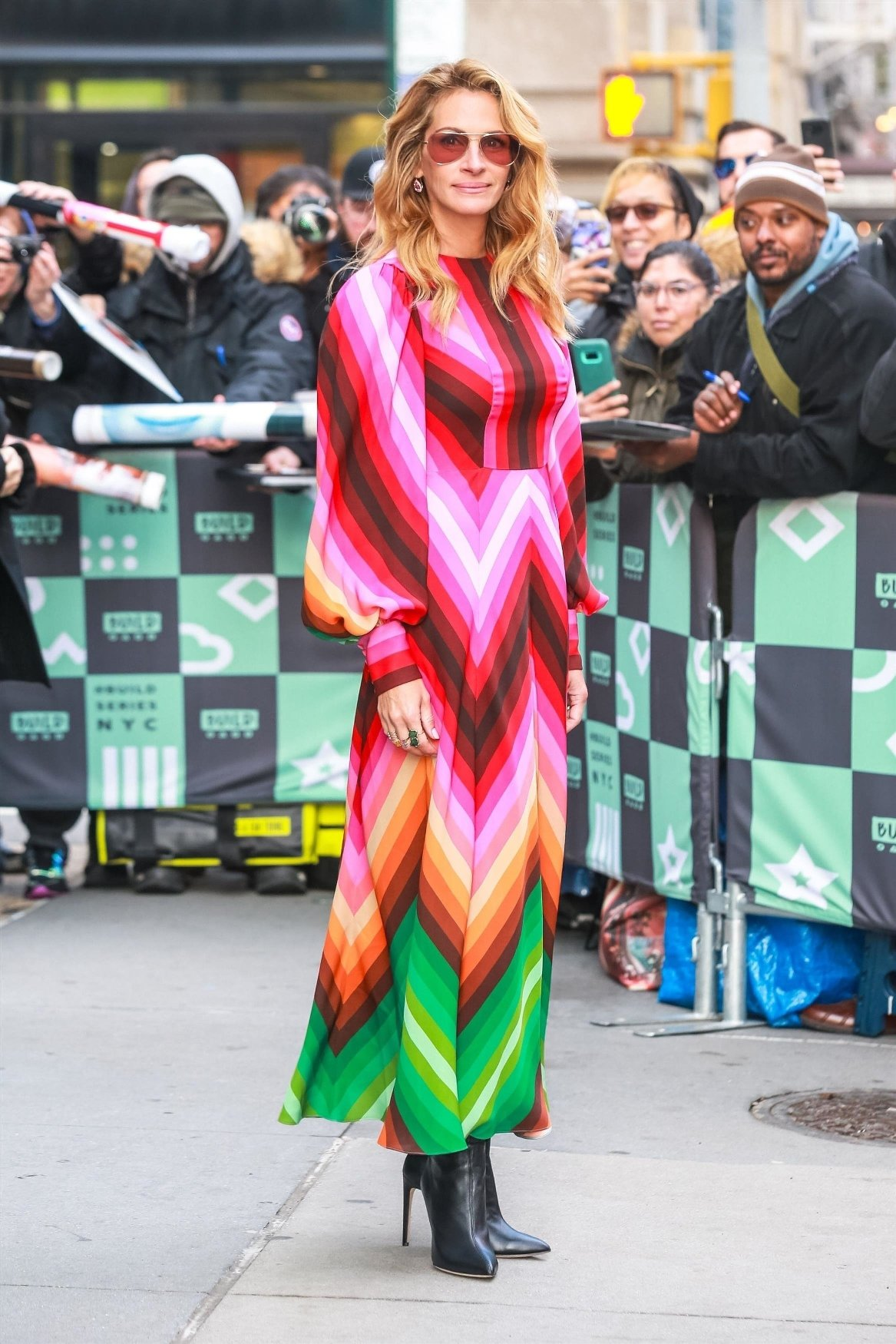 New York, NY  - Julia Roberts looks stunning as she stops by the Build Series in a multicolored dress in New York. Julia stopped to sign autographs for all of her waiting fans before heading inside.  Pictured: Julia Roberts    *UK Clients - Pictures Containing Children Please Pixelate Face Prior To Publication*, Image: 400090935, License: Rights-managed, Restrictions: , Model Release: no, Credit line: Profimedia, AKM-GSI