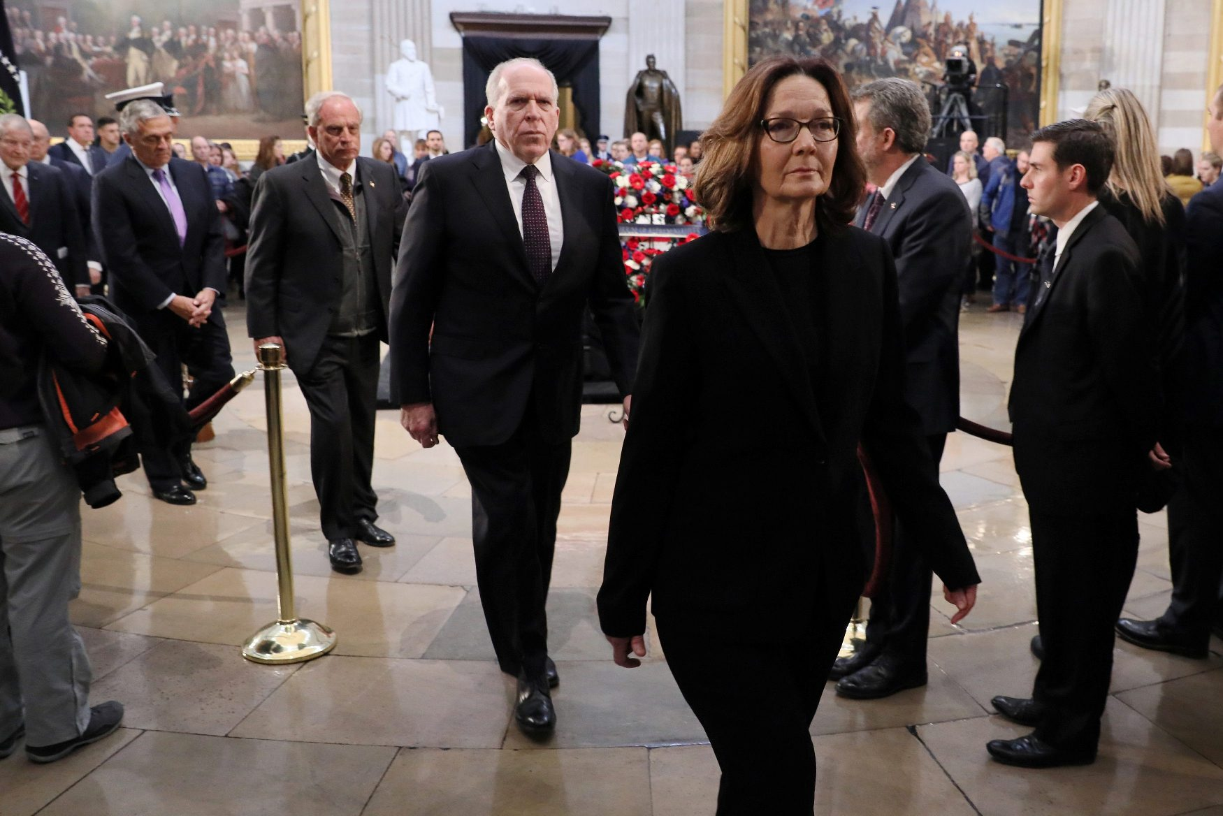 U.S. Central Intelligence Agency (CIA) Director Gina Haspel (R) leads former CIA directors including George Tenet, Porter Goss and John Brennan as they depart after paying their respects to former U.S. President George H. W. Bush as his body lies in state inside the Rotunda of the U.S. Capitol in Washington, U.S., December 4, 2018. REUTERS/Jonathan Ernst
